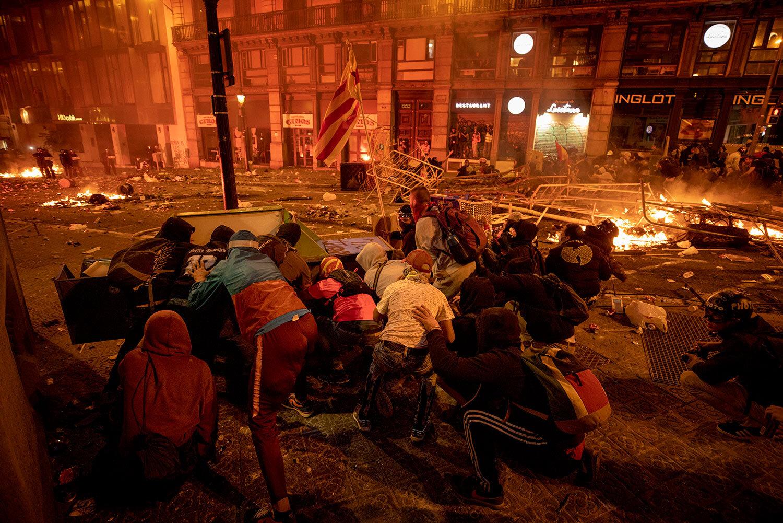 Demonstrators clash with police in Barcelona, Spain, Friday, Oct. 18, 2019. (AP Photo/Emilio Morenatti)