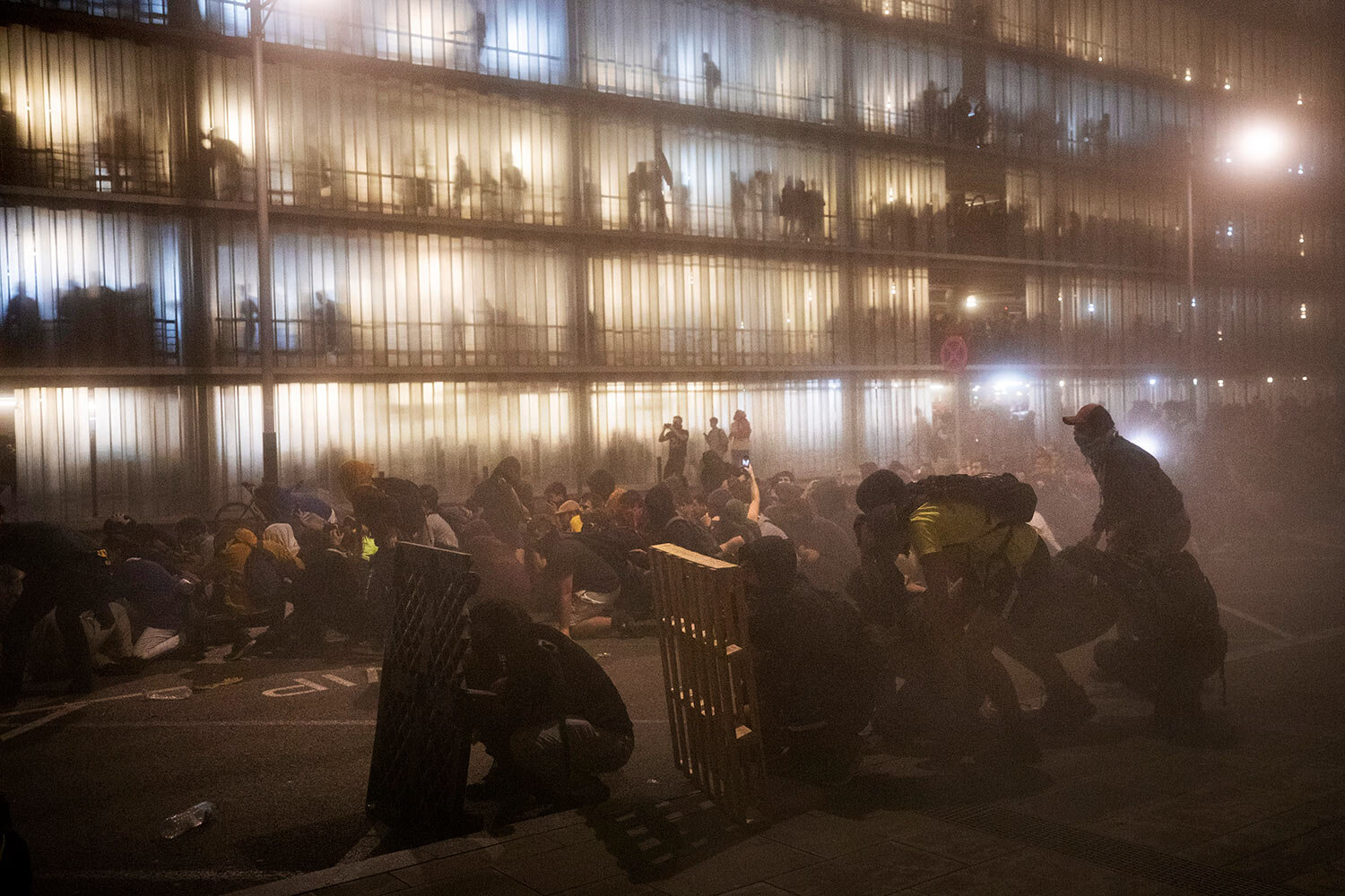 Protesters make a barricade during clashes with police outside El Prat airport in Barcelona, Spain, Monday, Oct. 14, 2019. (AP Photo/Emilio Morenatti)