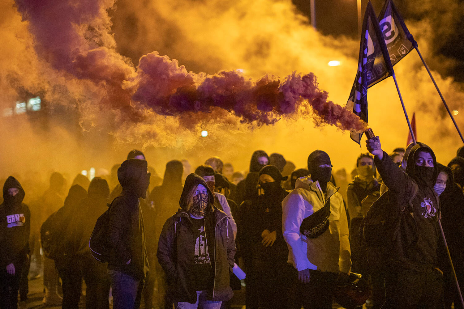 Pro-independence demonstrators, some of them holding flares, march as they take part in a protest in Girona, Spain, Tuesday Oct. 1, 2019. (AP Photo/Emilio Morenatti)