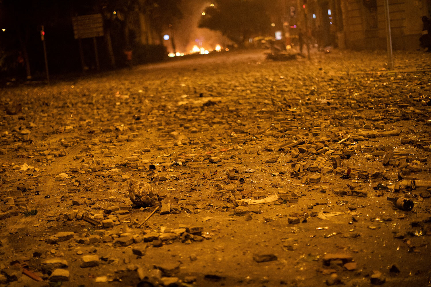 A street full of stones during clashes between police and Catalan pro-independence protestors in Barcelona, Spain, Friday, Oct. 18, 2019.(AP Photo/Bernat Armangue)