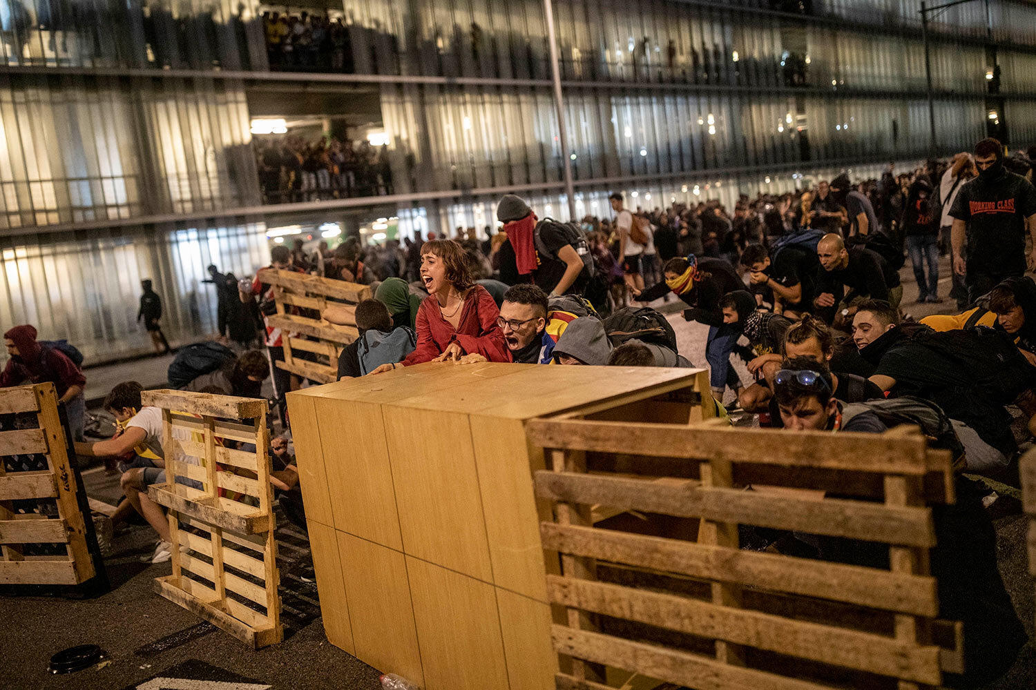 Protesters use makeshift barricades during a demonstration at El Prat airport, outskirts of Barcelona, Spain, Monday, Oct. 14, 2019. (AP Photo/Bernat Armangue)