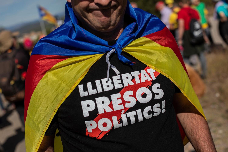 A Catalan pro-independence marches near Navas, Spain, Wednesday, Oct. 16, 2019. (AP Photo/Bernat Armangue)