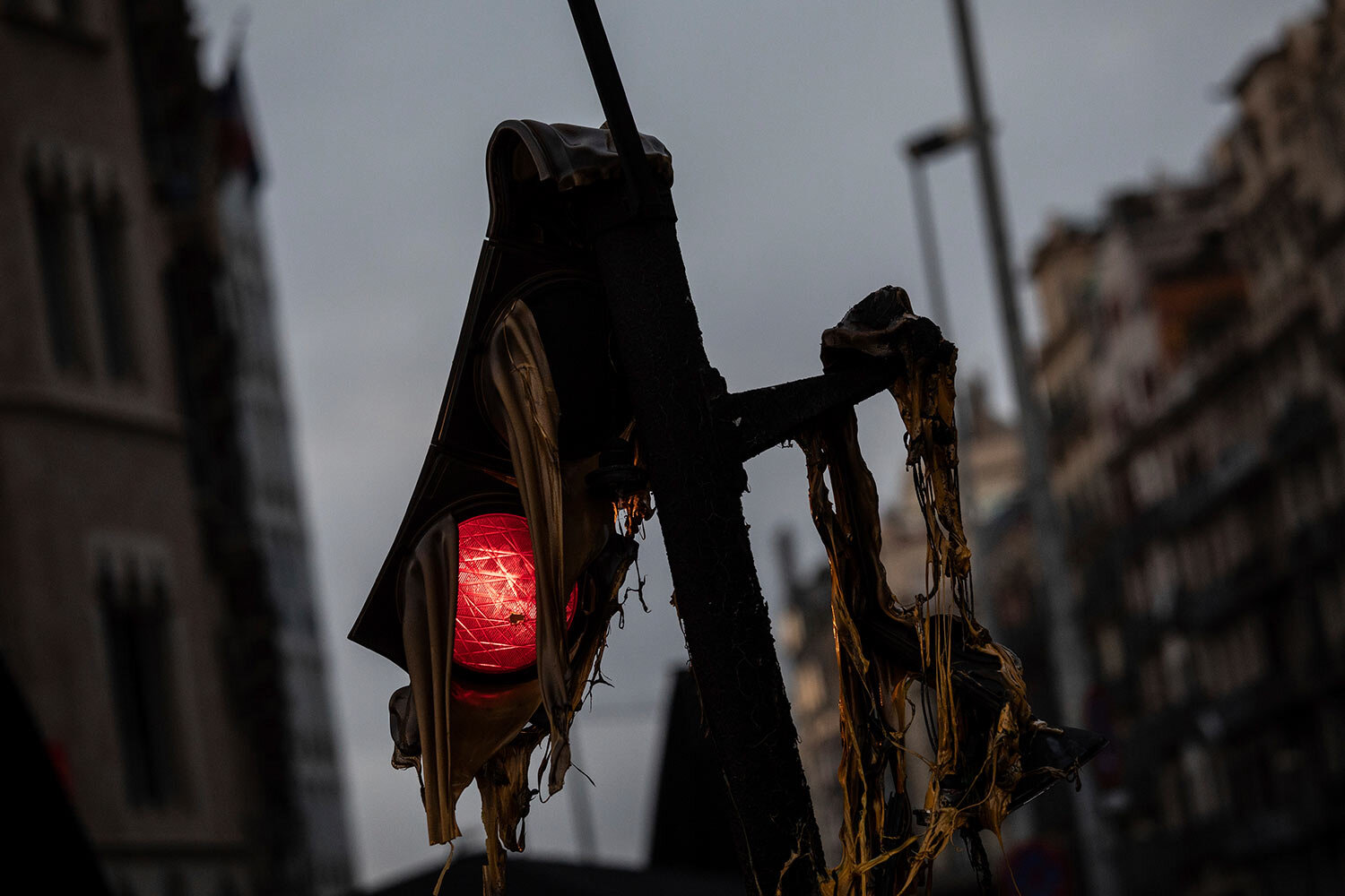A damaged traffic light, following Friday clashes between protestors and police, in Barcelona, Spain, Saturday, Oct. 19, 2019. (AP Photo/Bernat Armangue)