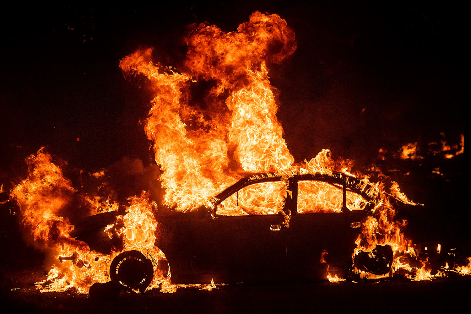 Flames from the Kincade Fire consume a car in the Jimtown community of unincorporated Sonoma County, Calif., on Thursday, Oct. 24, 2019. Wildfires are growing deadlier and more destructive amid climate change. (AP Photo/Noah Berger)
