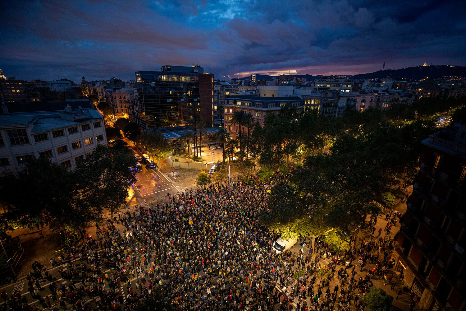 Pro-independence demonstrators gather next to the department of Interior in Catalonia, during a demonstration in Barcelona, Spain, Monday, Oct. 21, 2019. Protesters are angered by a Supreme Court verdict that sentenced nine separatist leaders to prison. (AP Photo/Emilio Morenatti)