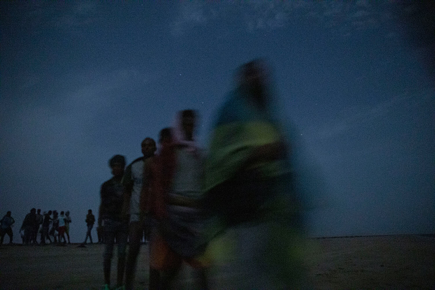 Ethiopian migrants stand in line to board a boat on the uninhabited coast outside the town of Obock, Djibouti, the shore closest to Yemen. (AP Photo/Nariman El-Mofty)