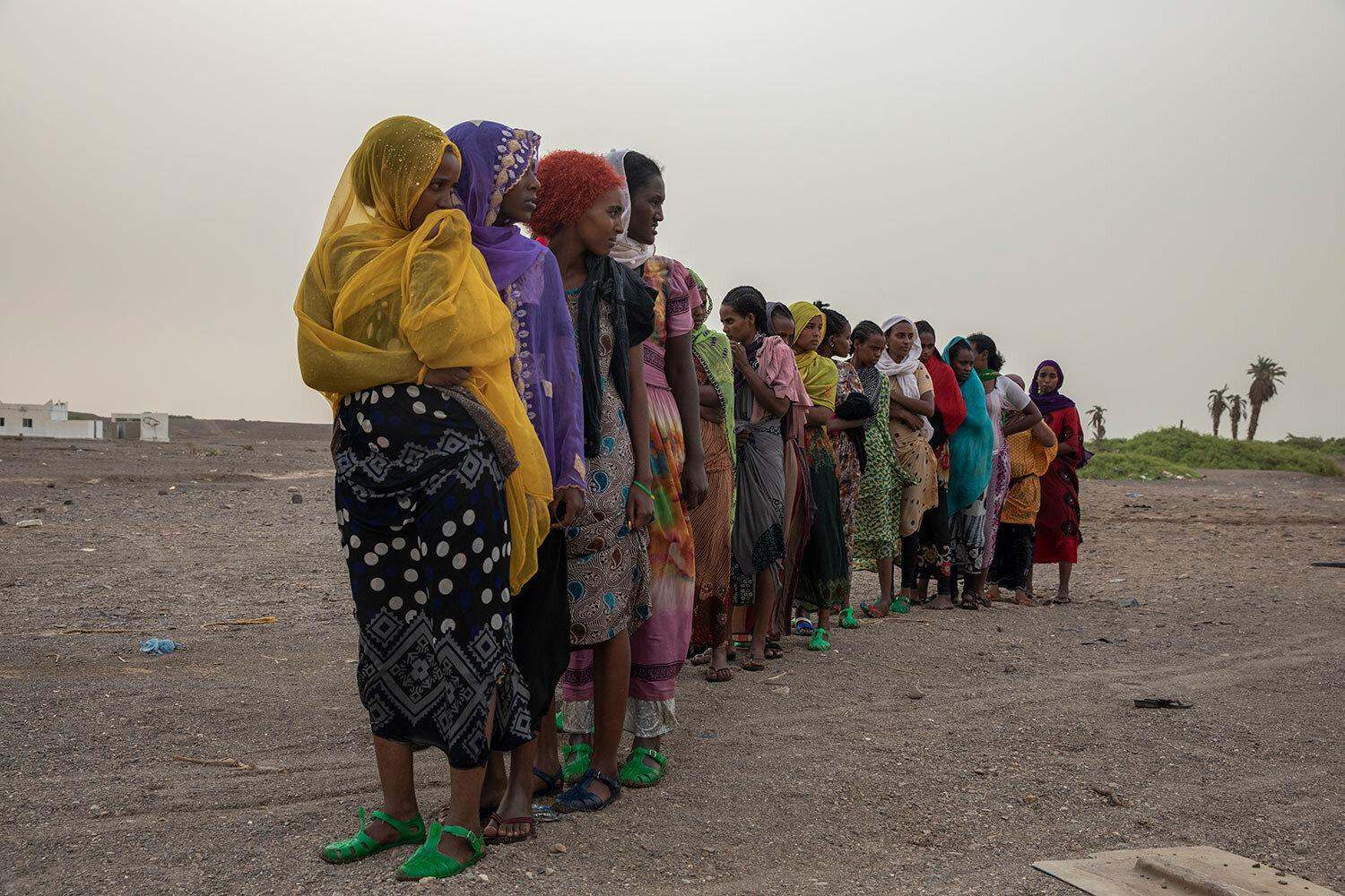 Ethiopian Tigray migrants stand in line to be counted by smugglers in Lahj, Yemen after arriving to the coastal village of Ras al-Ara from Djibouti. (AP Photo/Nariman El-Mofty)