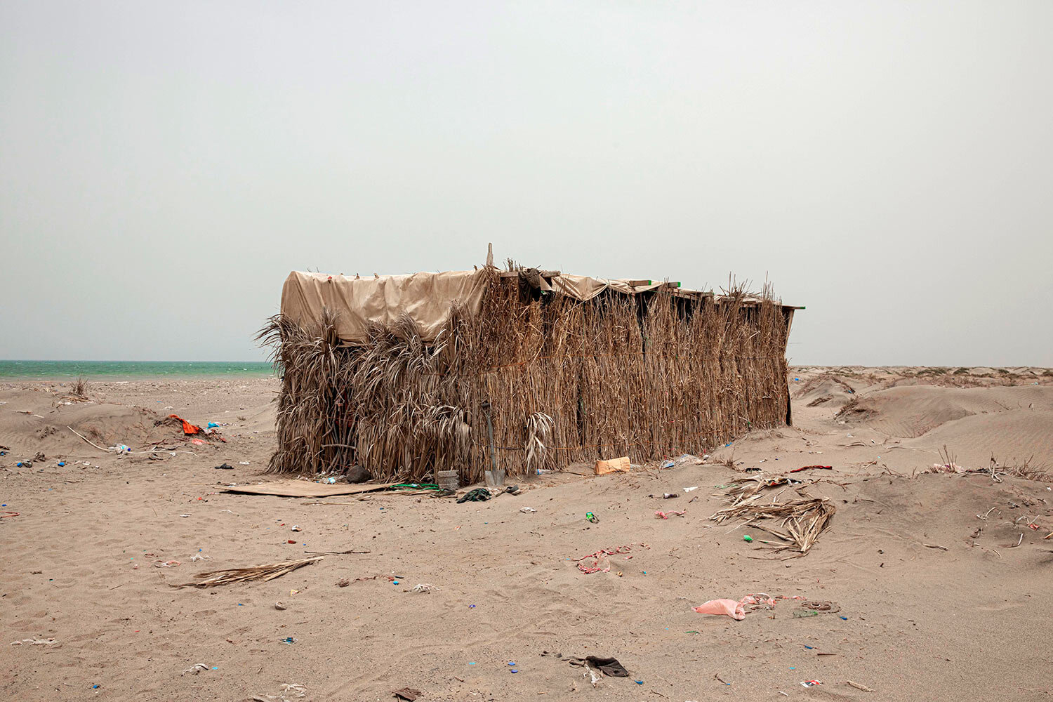 A hosh owned by smugglers is shown where migrants stay after their arrival, in Lahj, Yemen. (AP Photo/Nariman El-Mofty)