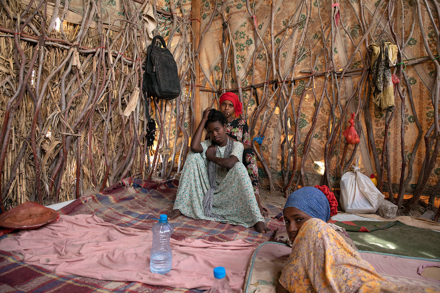 "Ethiopian migrant girls sit inside in a compound known in Arabic as a ""hosh,"" in Ras al-Ara, Lahj, Yemen. (AP Photo/Nariman El-Mofty)"