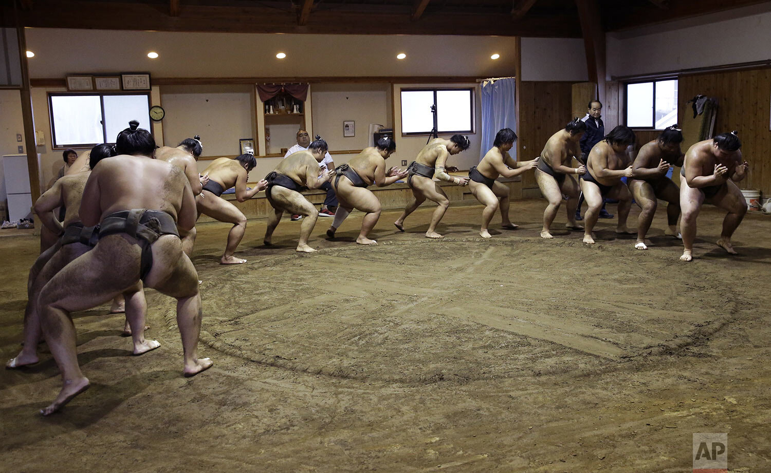 Sumo wrestlers perform an exercise during training at the Musashigawa Sumo Stable in Beppu, western Japan, riday, Oct. 18, 2019. (AP Photo/Aaron Favila)