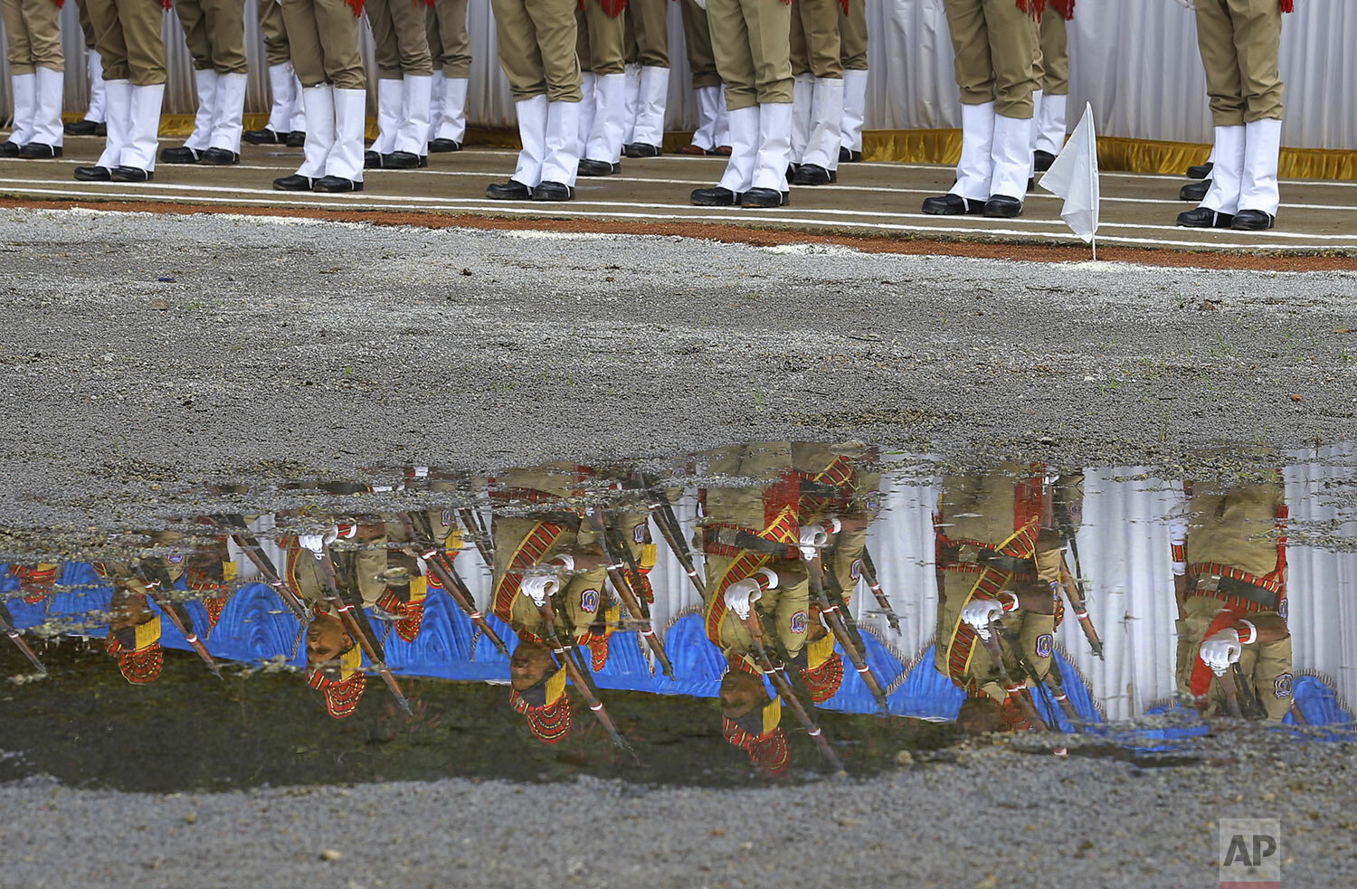 Indian policemen pay homage to mark Police Commemoration Day in Hyderabad, India, Monday, Oct. 21, 2019.  (AP Photo/Mahesh Kumar A., File)