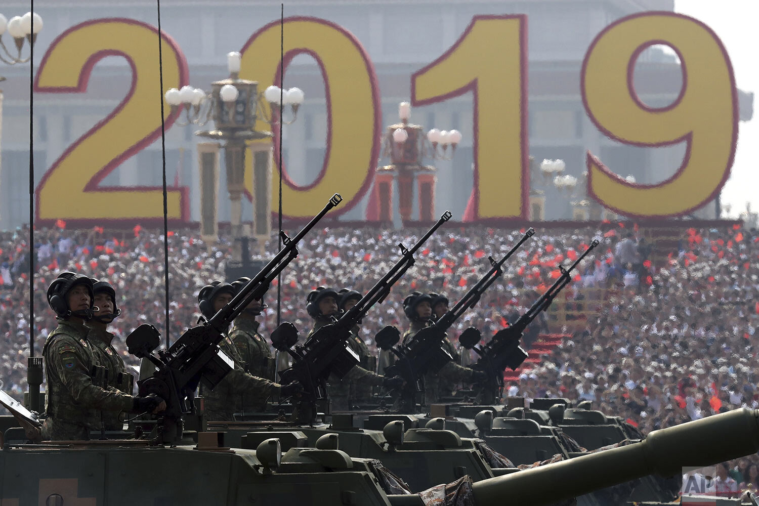 Army vehicles roll down during a parade to commemorate the 70th anniversary of the founding of Communist China in Beijing, Tuesday, Oct. 1, 2019. (AP Photo/Ng Han Guan)