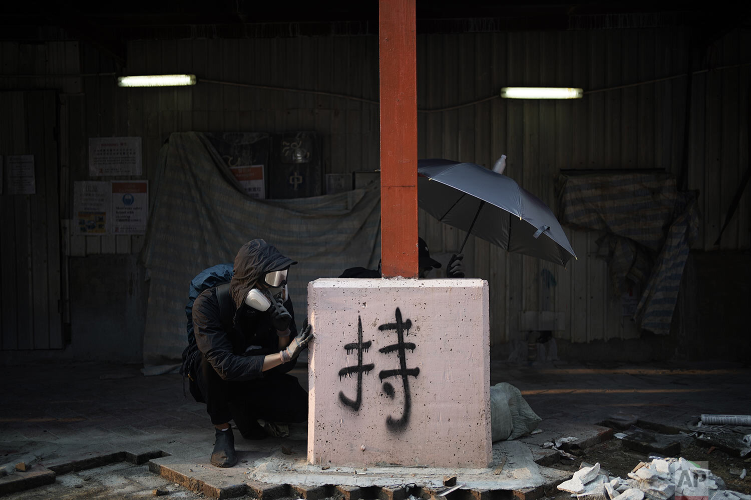 Protesters take position during a confrontation with police in Hong Kong, Sunday, Oct. 20, 2019. Hong Kong protesters again flooded streets on Sunday, ignoring a police ban on the rally and setting up barricades amid tear gas and firebombs. (AP Photo//Felipe Dana)