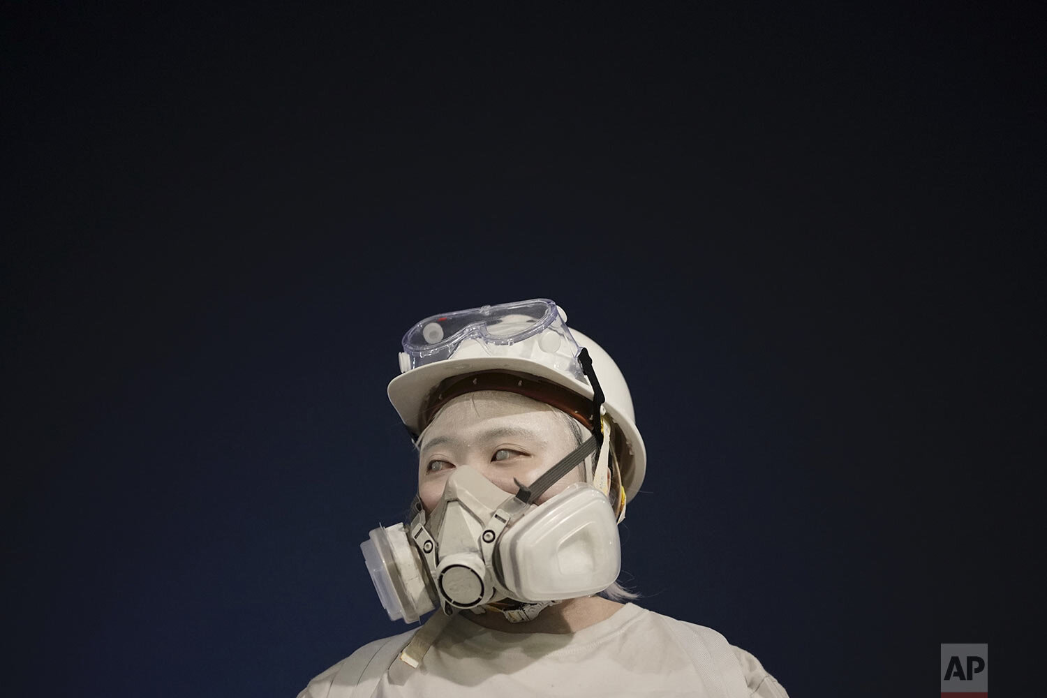 A protester wears a mask during a protest in Hong Kong, Friday, Oct. 18, 2019.  (AP Photo/Felipe Dana)