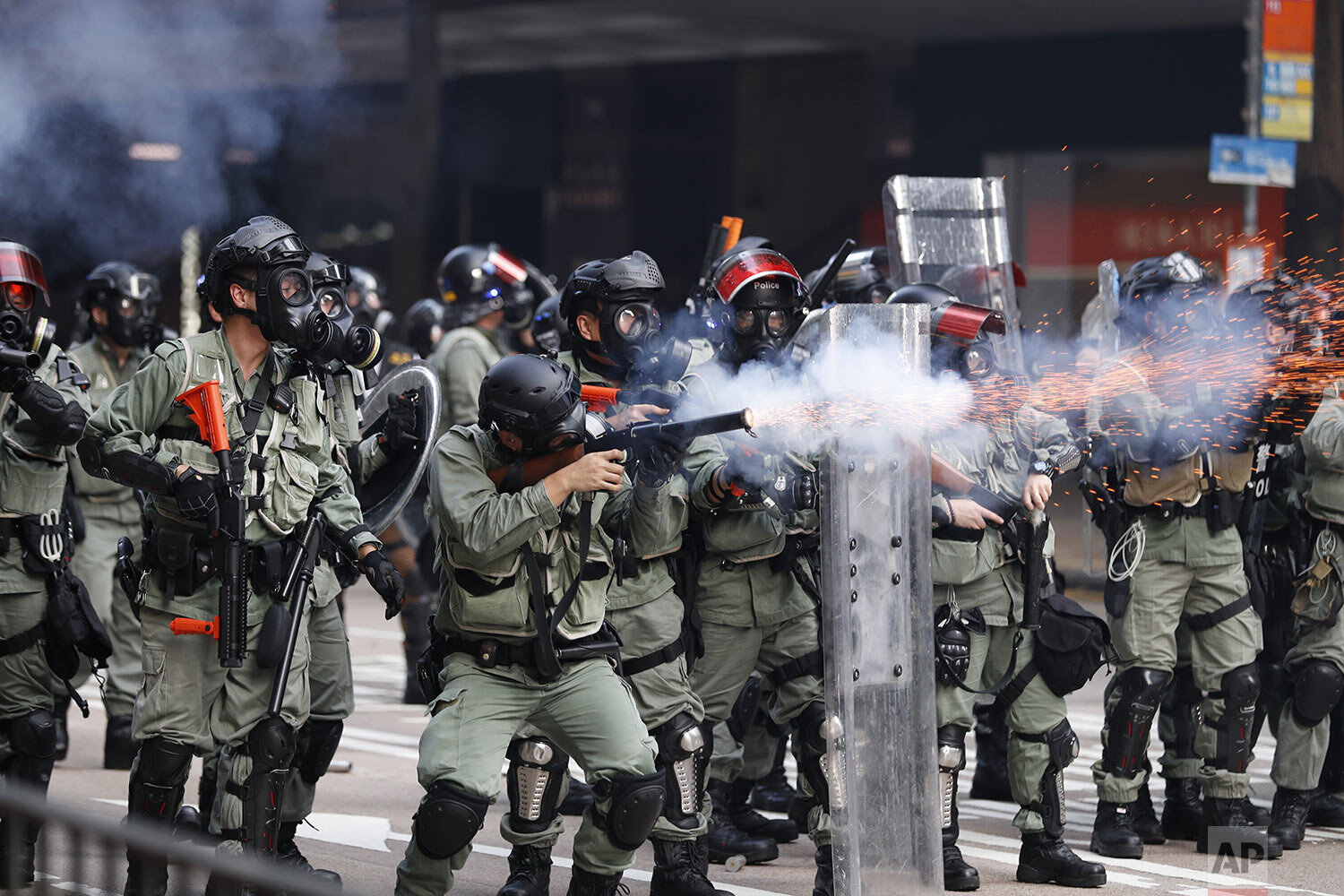 Police fire tear gas to disperse anti-government protesters in Hong Kong, Tuesday, Oct. 1, 2019.  (AP Photo/Vincent Thian)