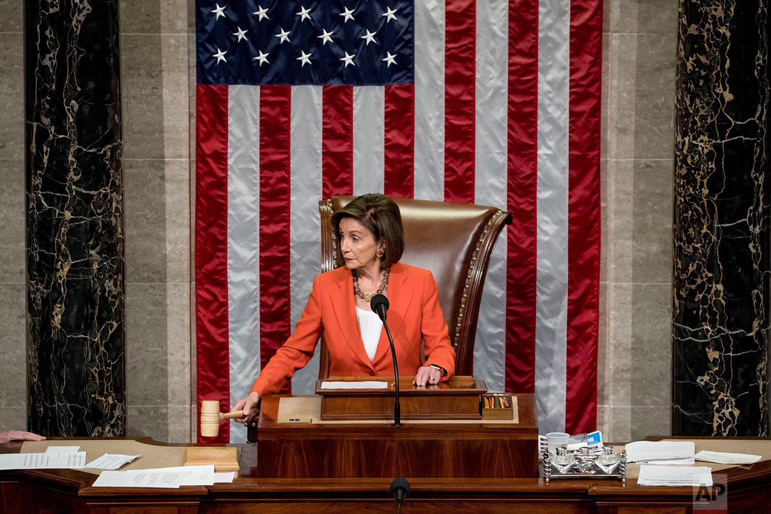 House Speaker Nancy Pelosi, D-Calif., gavels as the House votes 232-196 to pass a resolution on impeachment procedure to move forward into the next phase of the impeachment inquiry into President Donald Trump in the House Chamber on Capitol Hill in Washington, Thursday, Oct. 31, 2019. The resolution would authorize the next stage of impeachment inquiry into the president, including establishing the format for open hearings, giving the House Committee on the Judiciary the final recommendation on impeachment, and allowing Trump and his lawyers to attend events and question witnesses. (AP Photo/Andrew Harnik)