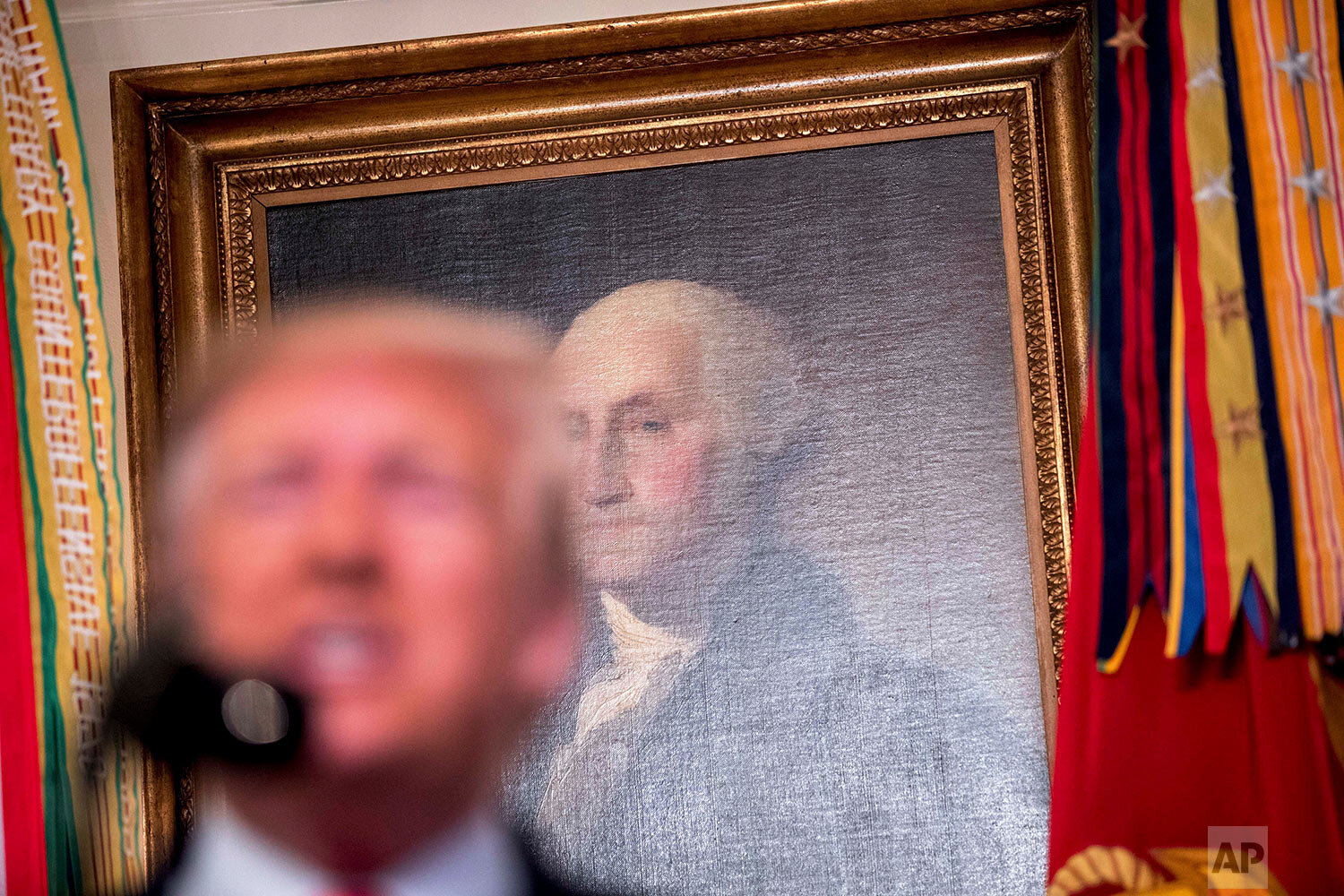 President Donald Trump speaks in front of a painting of former President George Washington in the Diplomatic Room of the White House in Washington, Sunday, Oct. 27, 2019, to announce that Islamic State leader Abu Bakr al-Baghdadi has been killed during a U.S. raid in Syria. (AP Photo/Andrew Harnik)