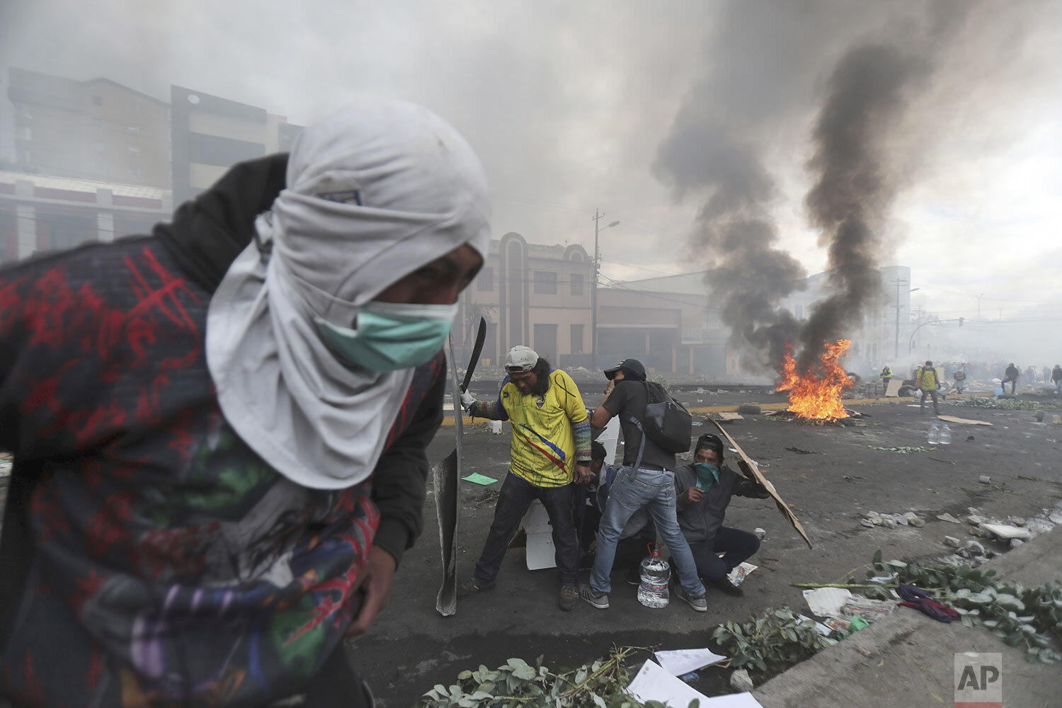 Anti-government demonstrators clash with the police near the national assembly building in Quito, Ecuador, Saturday, Oct. 12, 2019. Indigenous leaders of protests that have paralyzed Ecuador's economy for nearly a week say they are willing to negotiate with President Lenin Moreno, signaling a possible exit from the crisis, which was triggered by the cancellation of fuel subsidies by Moreno. (AP Photo/Dolores Ochoa)