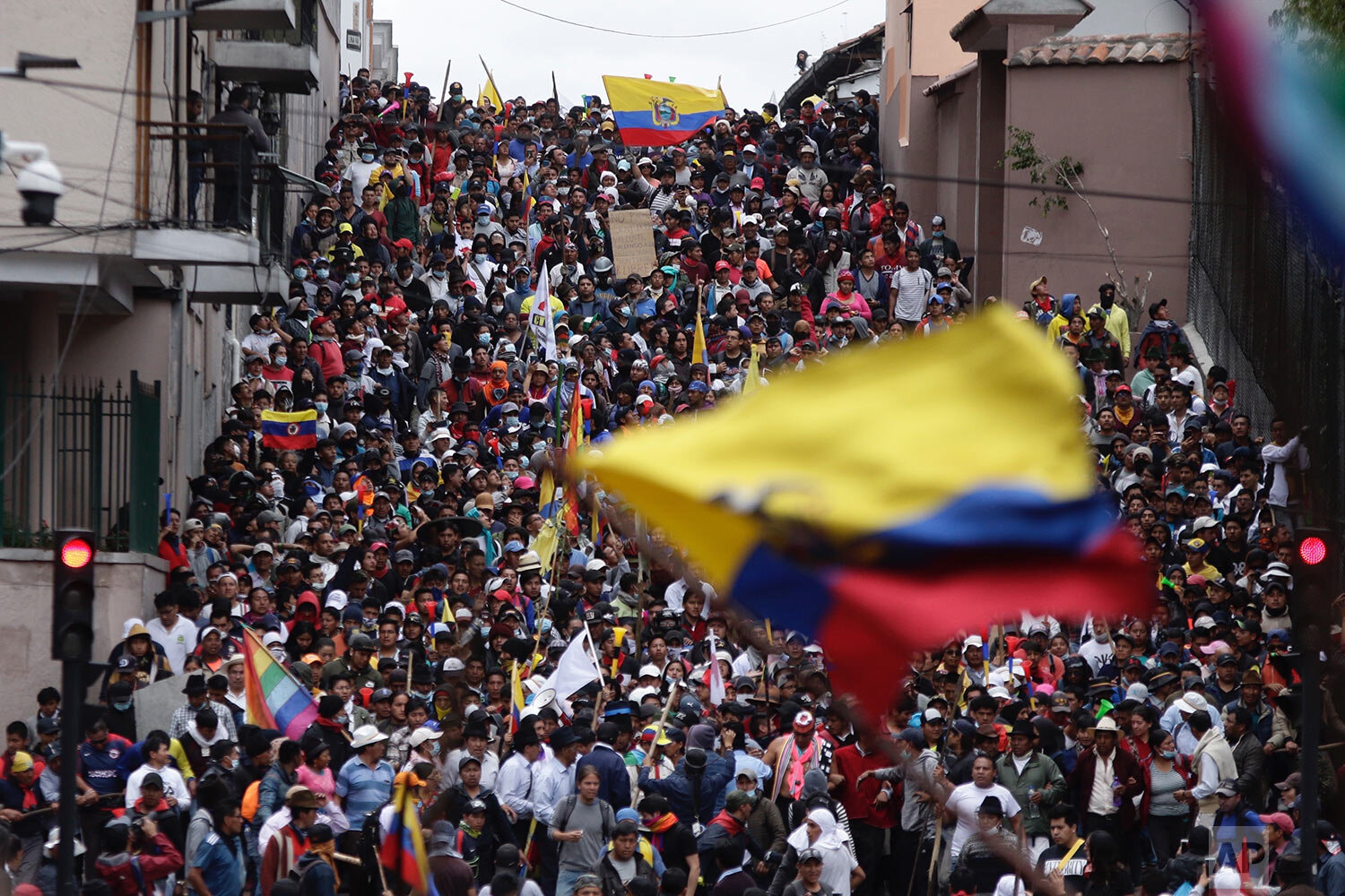 Anti-government demonstrators march against President Lenin Moreno and his economic policies during a nationwide strike, in Quito, Ecuador, Wednesday, Oct. 9, 2019. Ecuador's military has warned people who plan to participate in a national strike over fuel price hikes to avoid acts of violence. The military says it will enforce the law during the planned strike Wednesday, following days of unrest that led Moreno to move government operations from Quito to the port of Guayaquil. (AP Photo/Carlos Noriega)