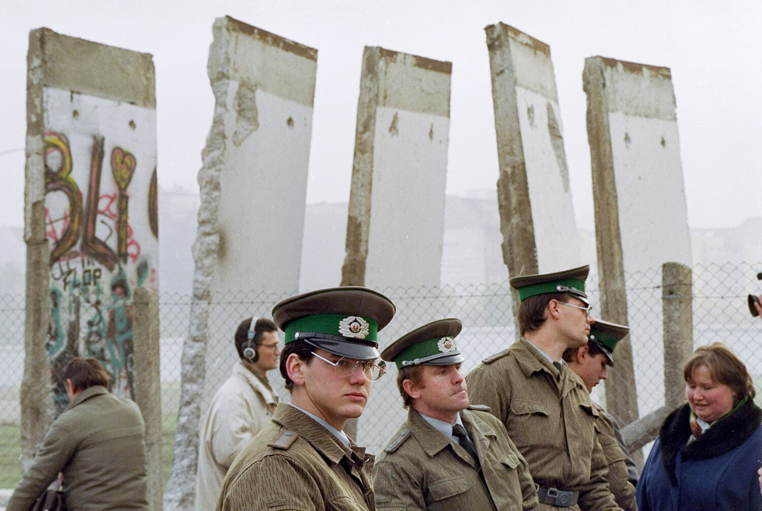 East German border guards stand in front of segments of the Berlin Wall, which were removed to open the wall at Potsdamer Platz passage, Nov. 13, 1989, in Berlin. (AP Photo/John Gaps III, File)