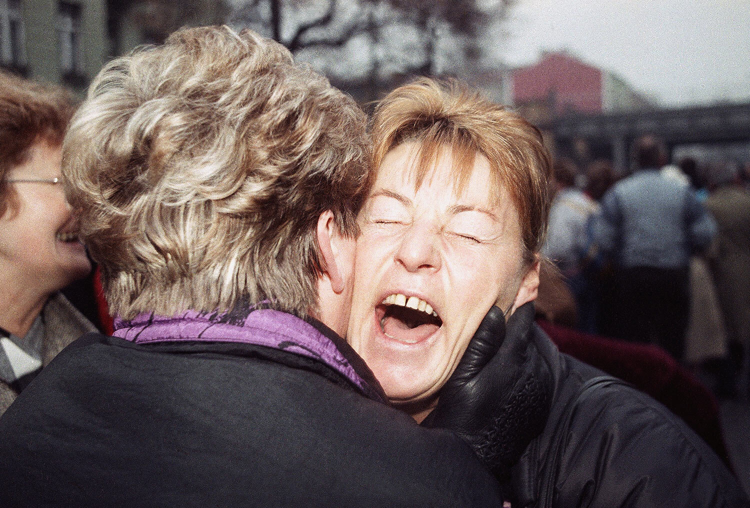 East German Rosemarie Doln is overwhelmed with emotion as she is welcomed by an unidentified relative at the opening of latest wall passage at Wollankstrasse in West Berlin?s district of Wedding, Nov. 13, 1989 in Berlin. (AP Photo/John Gaps III)