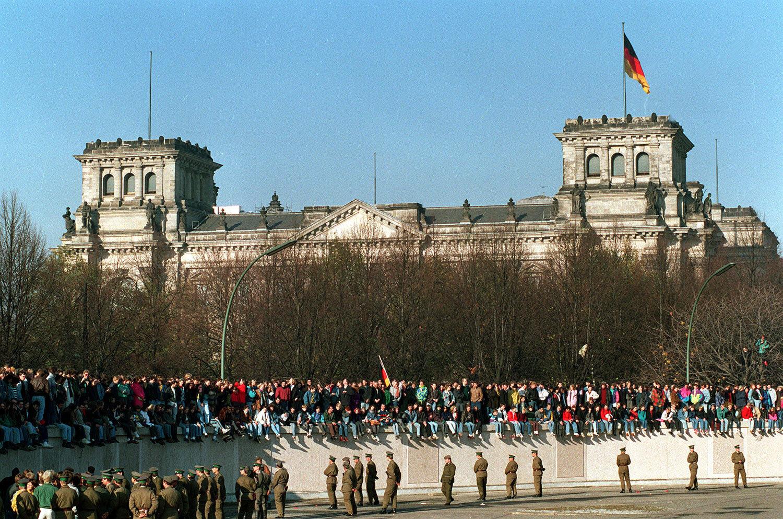 Berliners sing and dance on top of the Berlin Wall to celebrate the opening of East-West German borders, Nov. 10, 1989, in Berlin. (AP Photo/Thomas Kienzle)