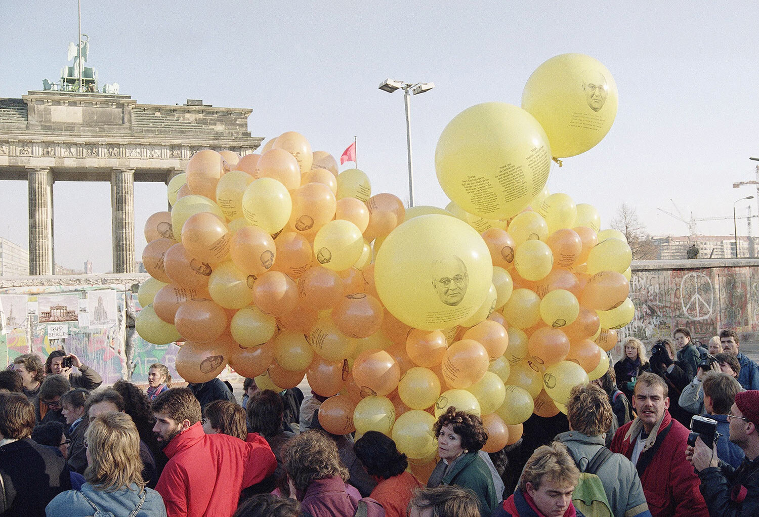 West Berliners release hundreds of balloons with photo of Mikhail S. Gorbachev and a message to the Soviet leader in front of Brandenburg Gate in West Berlin near the wall, Nov. 17, 1989. They wanted to say thank you to Soviet President Mikhail S. Gorbachev for pulling down the wall. (AP Photo/Thomas Kienzle)
