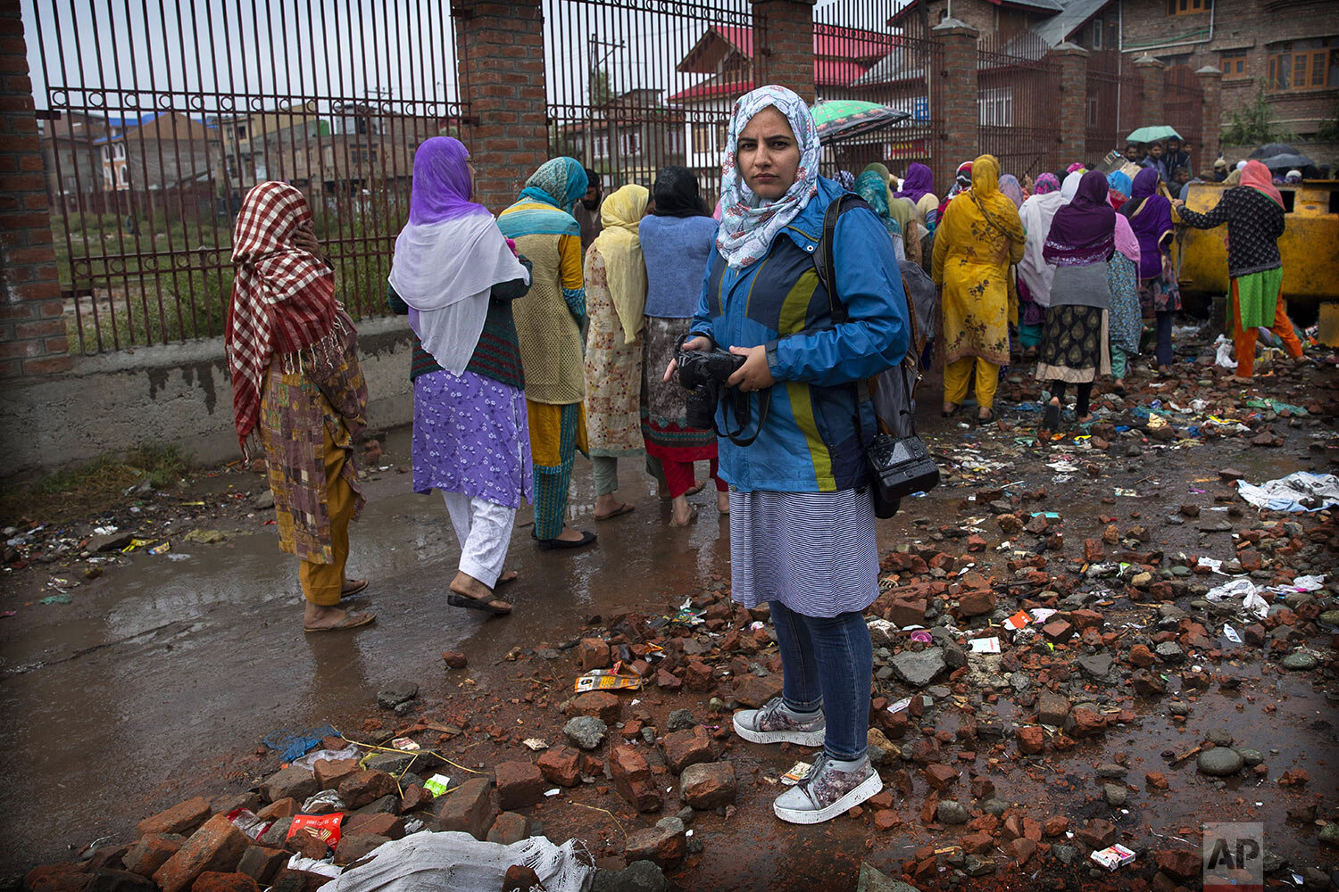 Photojournalist Masrat Zahra stands for a photograph during a protest on the outskirts of Srinagar, Indian controlled Kashmir, Friday, Oct. 4, 2019. (AP Photo/Dar Yasin)