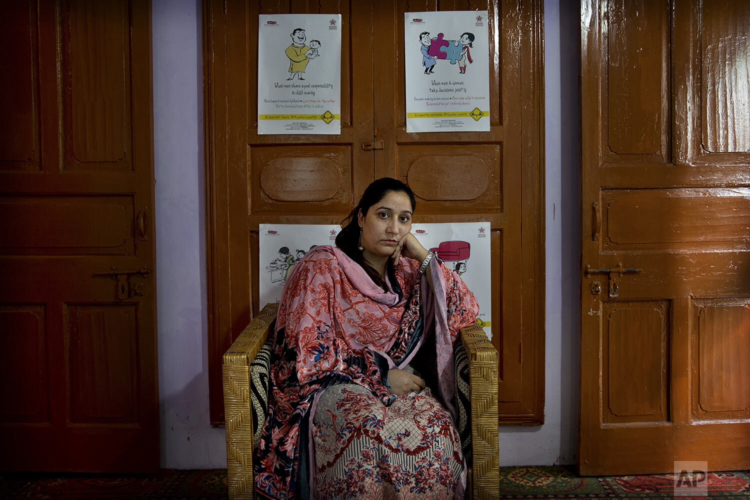 Mantasha Binti Rashid sits for a photograph in Srinagar, Indian-controlled Kashmir, Thursday, Oct. 24, 2019. (AP Photo/Dar Yasin)