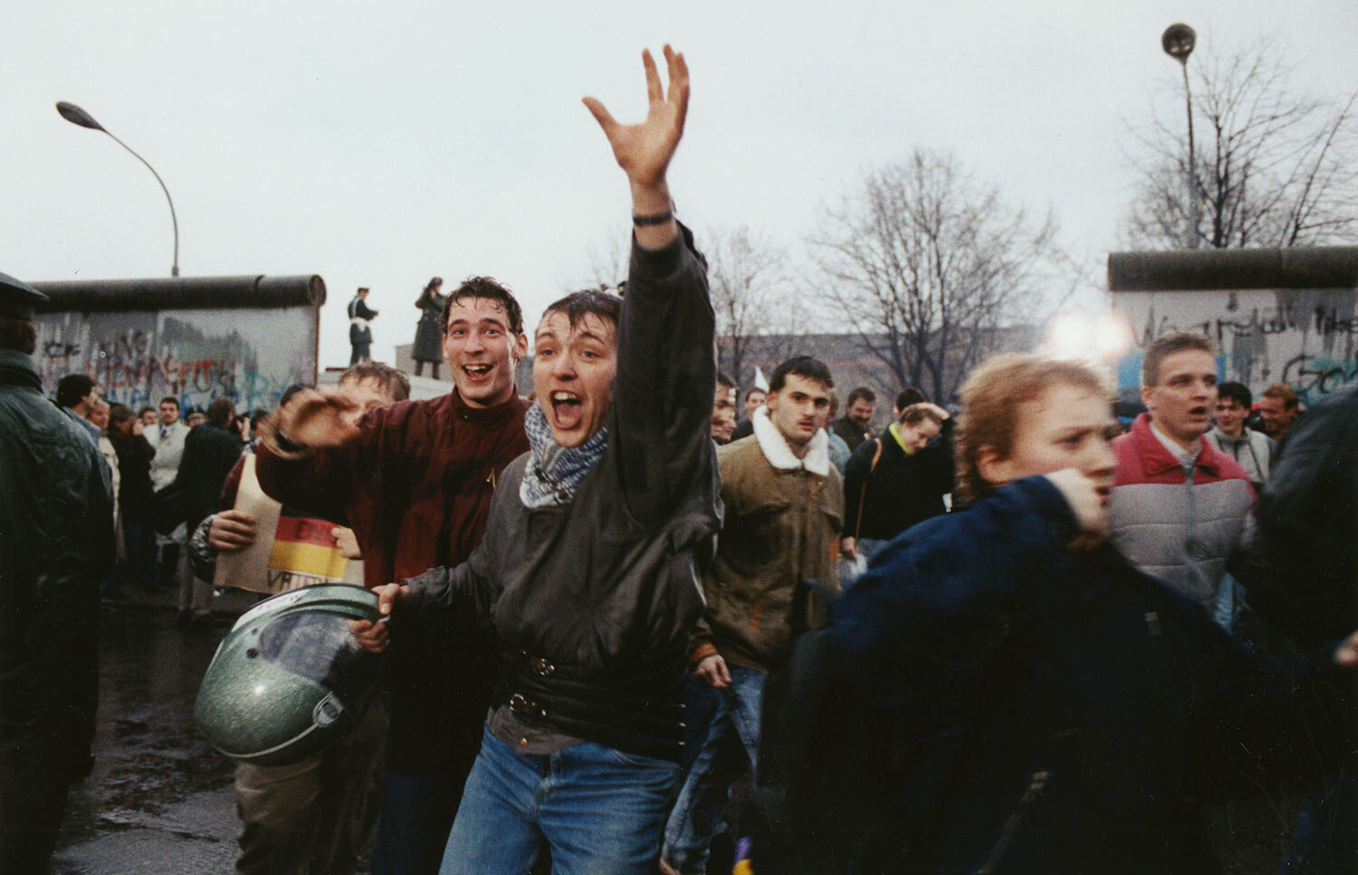 Young East Berliners shout for joy as they run into West Berlin through an opening in the Berlin Wall near the Brandenburg Gate, Fri., Dec. 23, 1989. The new East German government had promised to fully open the gate by Christmas. (AP Photo/Hansjoerg Krauss)