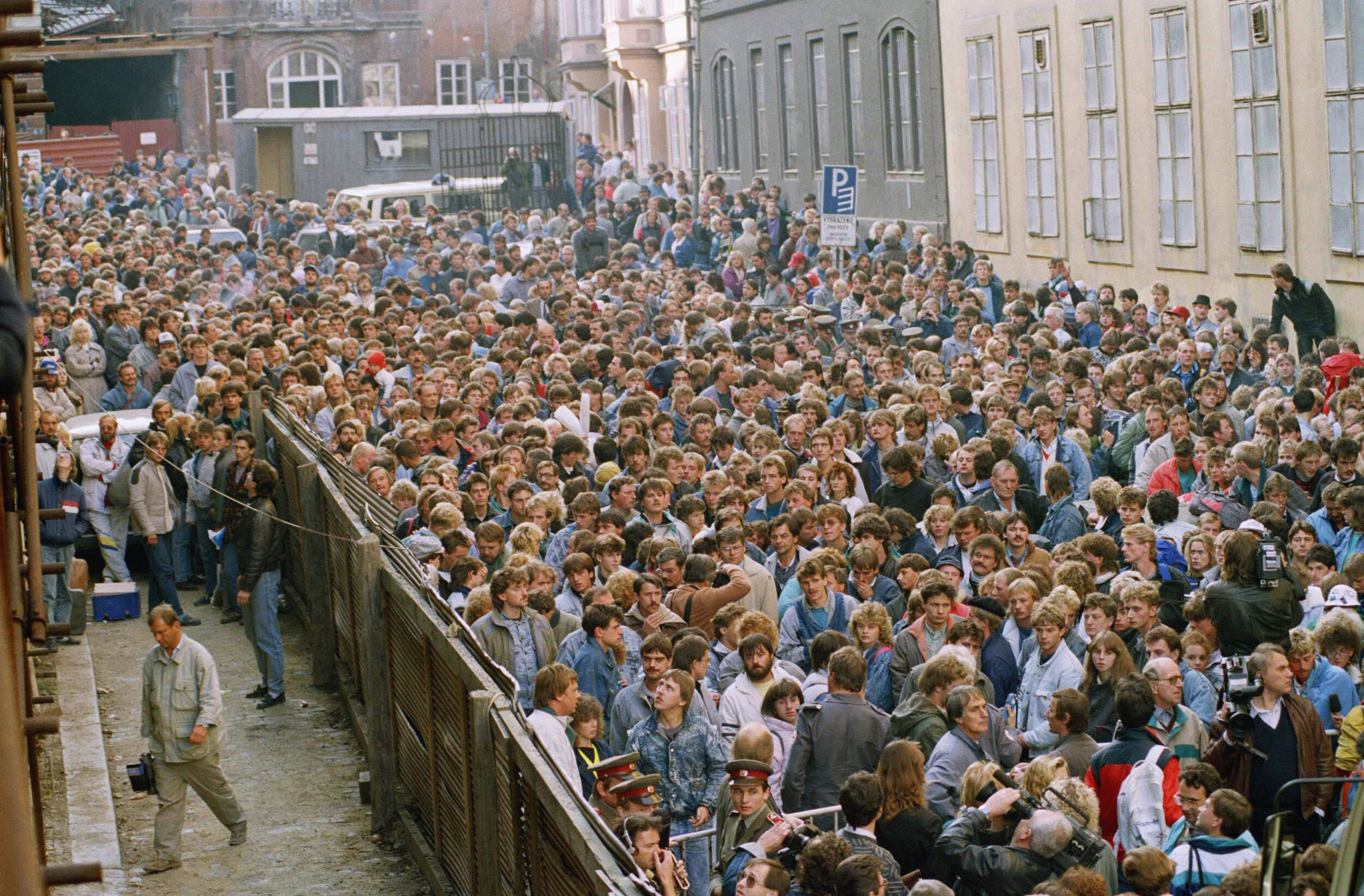 A crowd of about 10,000 East German refugees throng in the street outside the West German embassy in Prague, Czech Republic, before they are allowed to board busses to take them to special trains bound for West Germany, Wednesday, Oct. 4, 1989. (AP Photo/Dieter Endlicher)