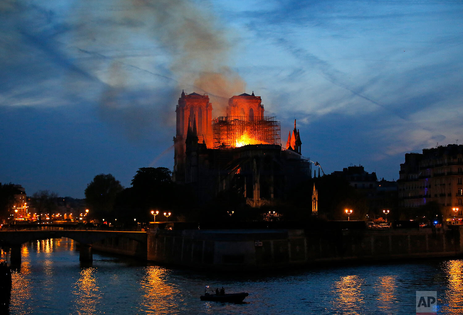 Flames and smoke rise from Notre Dame cathedral in Paris as firefighters tackle the blaze on April 15, 2019. (AP Photo/Michel Euler)