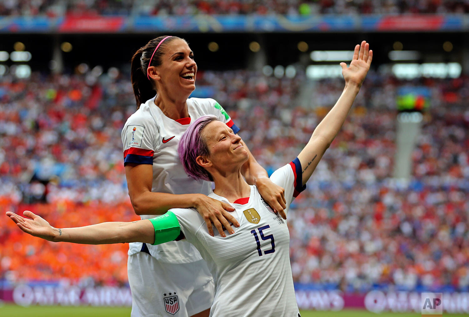 United States' Megan Rapinoe, right, celebrates with Alex Morgan after Rapinoe scored the opening goal from the penalty spot during the Women's World Cup final soccer match between the U.S. and The Netherlands at the Stade de Lyon in Decines, outside Lyon, France, on July 7, 2019. (AP Photo/Francisco Seco)