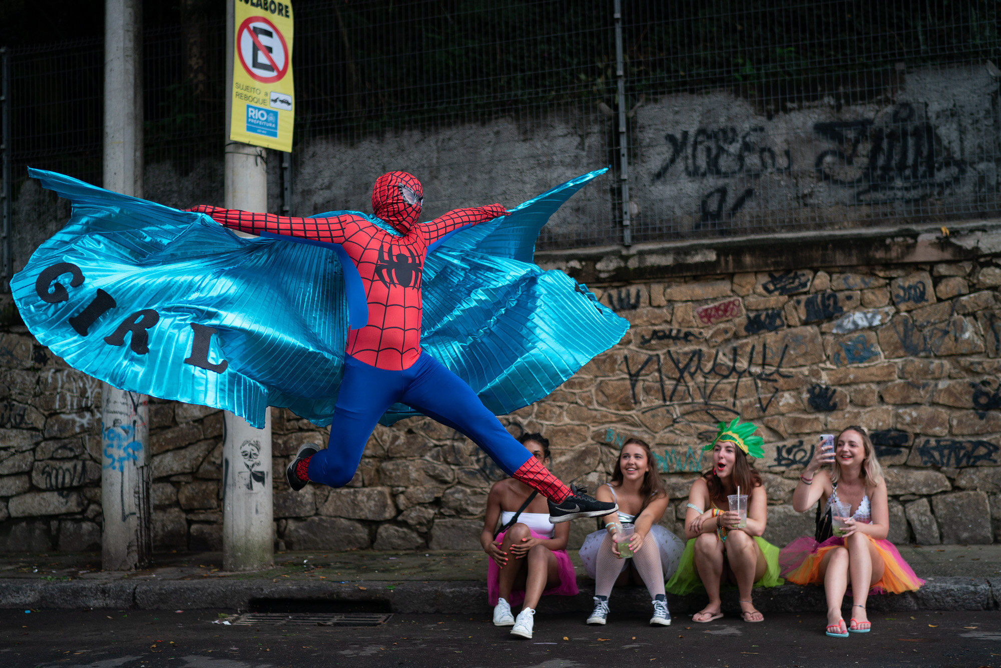 """A reveler dressed in a Spider-Man costume strikes a pose at the """"Ceu na Terra"""" or Heaven on Earth street party in Rio de Janeiro, Brazil on Feb. 22, 2020, during the Carnival celebration. (AP Photo/Leo Correa)"""