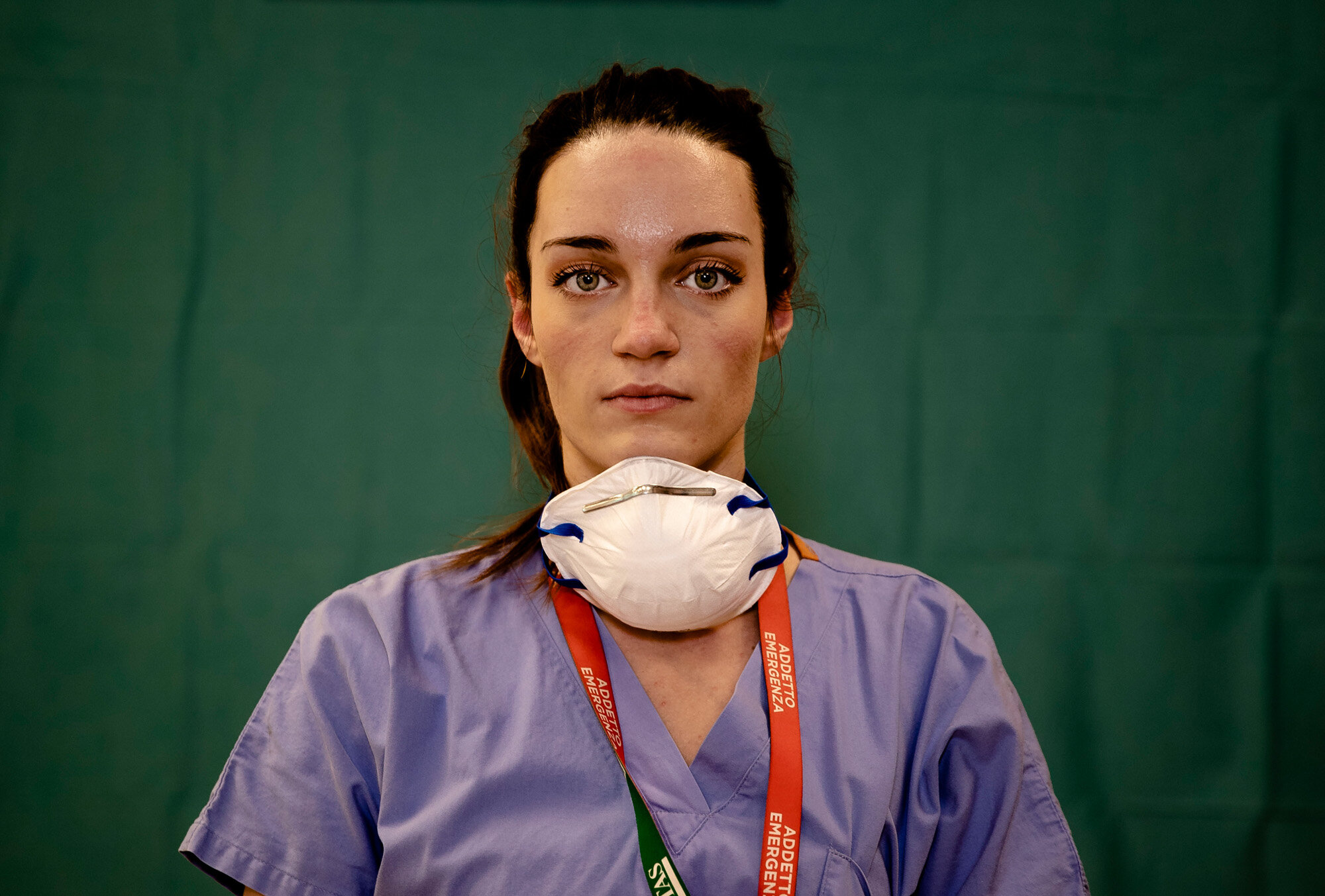Martina Papponetti, 25, a nurse at the Humanitas Gavazzeni Hospital in Bergamo, Italy, poses for a portrait at the end of her shift on the front lines of the coronavirus pandemic on March 27, 2020. (AP Photo/Antonio Calanni)