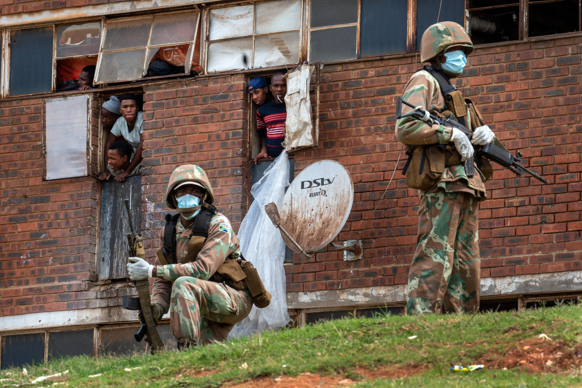 South African National Defense Forces patrol the Men's Hostel in the densely populated Alexandra township east of Johannesburg on March 28, 2020, enforcing a strict lockdown in an effort to control the spread of the coronavirus. (AP Photo/Jerome Delay)