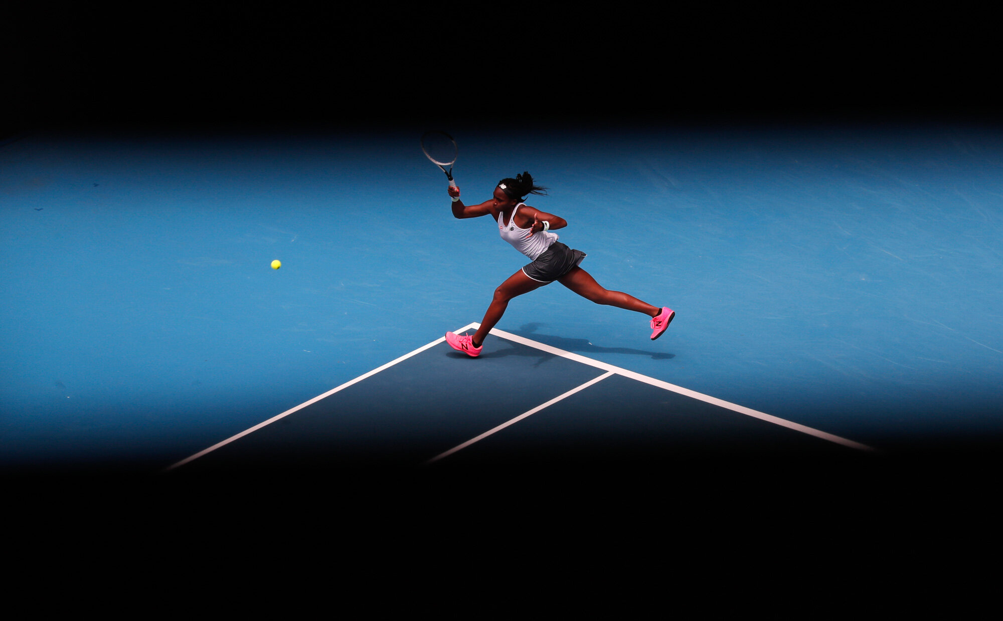 """Cori """"Coco"""" Gauff of the U.S. makes a forehand return to Romania's Sorana Cirstea during their second round singles match at the Australian Open tennis championship in Melbourne, Australia, on Jan. 22, 2020. (AP Photo/Lee Jin-man)"""