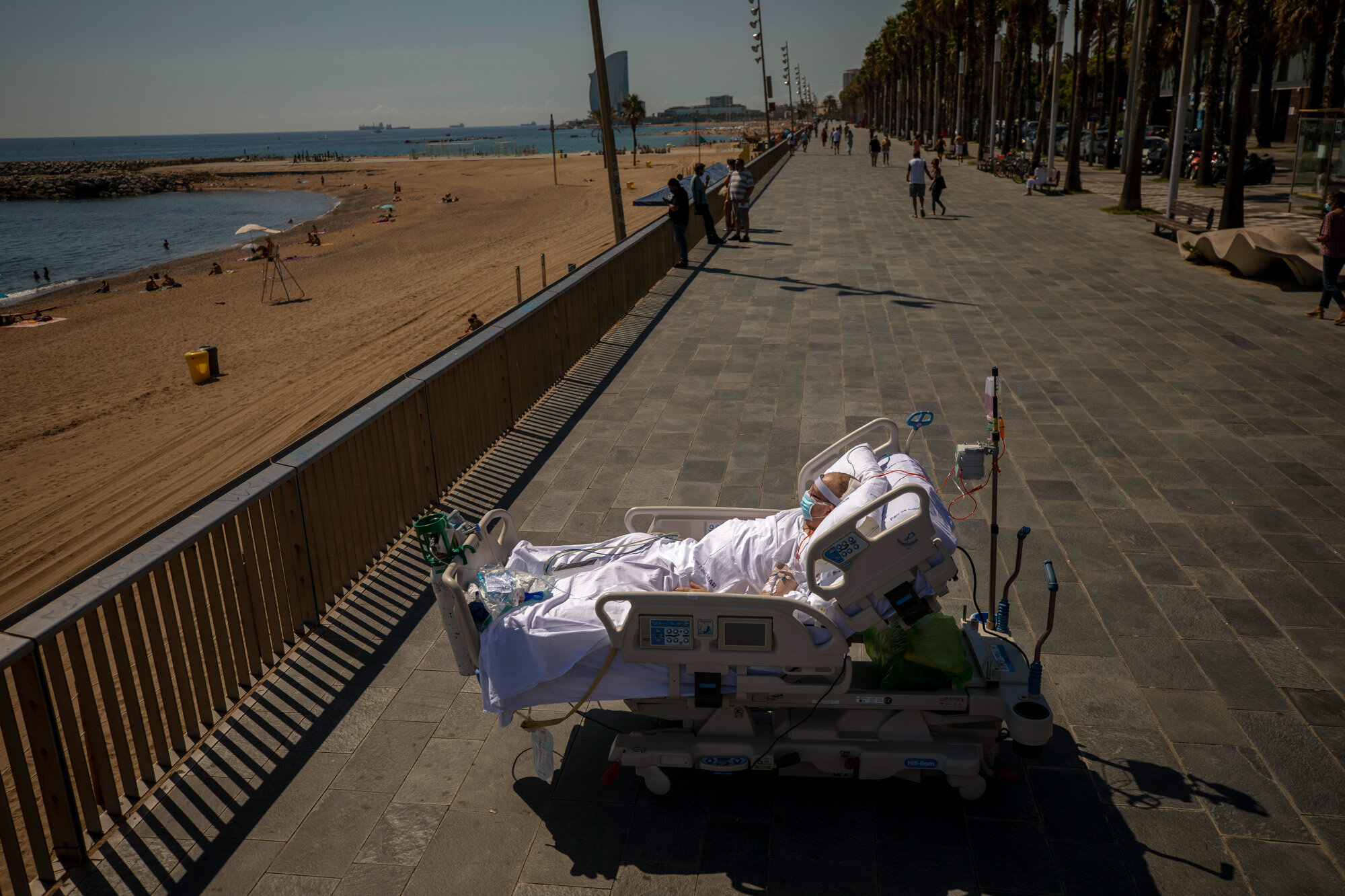 Francisco Espana looks at the Mediterranean sea from a promenade next to the Hospital del Mar in Barcelona, Spain, on Sept. 4, 2020. After 52 days in the hospital's intensive care unit due to the coronavirus, Francisco was allowed by his doctors to spend almost ten minutes at the seaside as part of his recovery therapy. (AP Photo/Emilio Morenatti)
