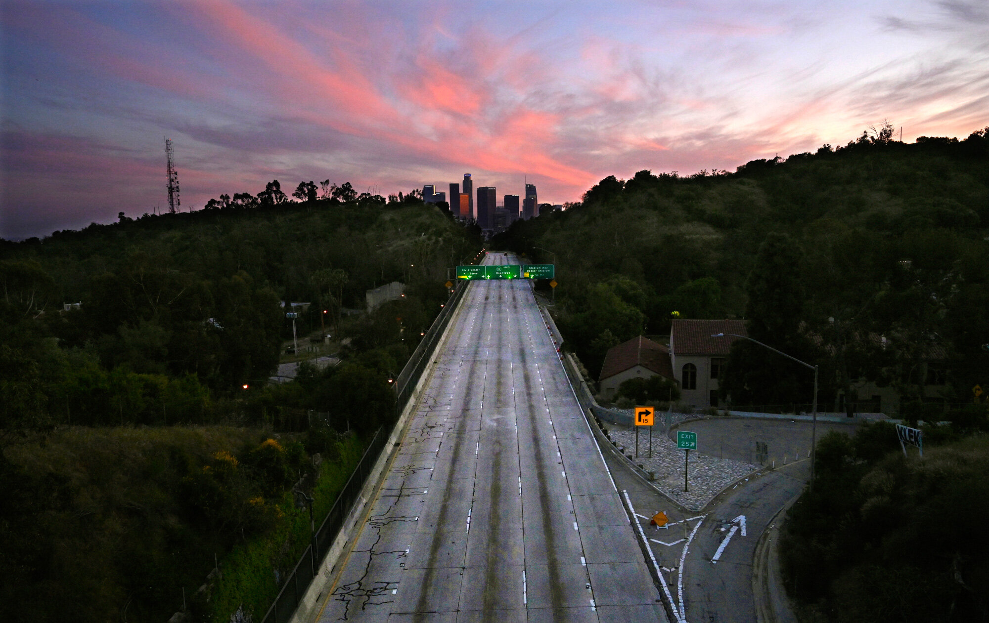 Lanes are empty on the 110 Arroyo Seco Parkway that leads to downtown Los Angeles on April 26, 2020, as California remains on lockdown to avoid the spread of the coronavirus. (AP Photo/Mark J. Terrill)