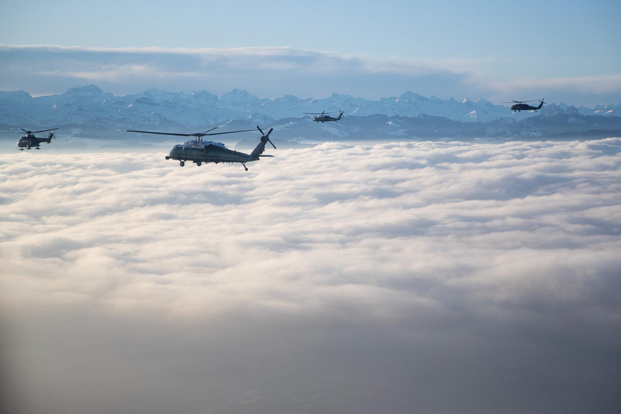 Marine One carrying U.S. President Donald Trump flies to Davos, Switzerland, for the World Economic Forum on Jan. 21, 2020. (AP Photo/Evan Vucci)