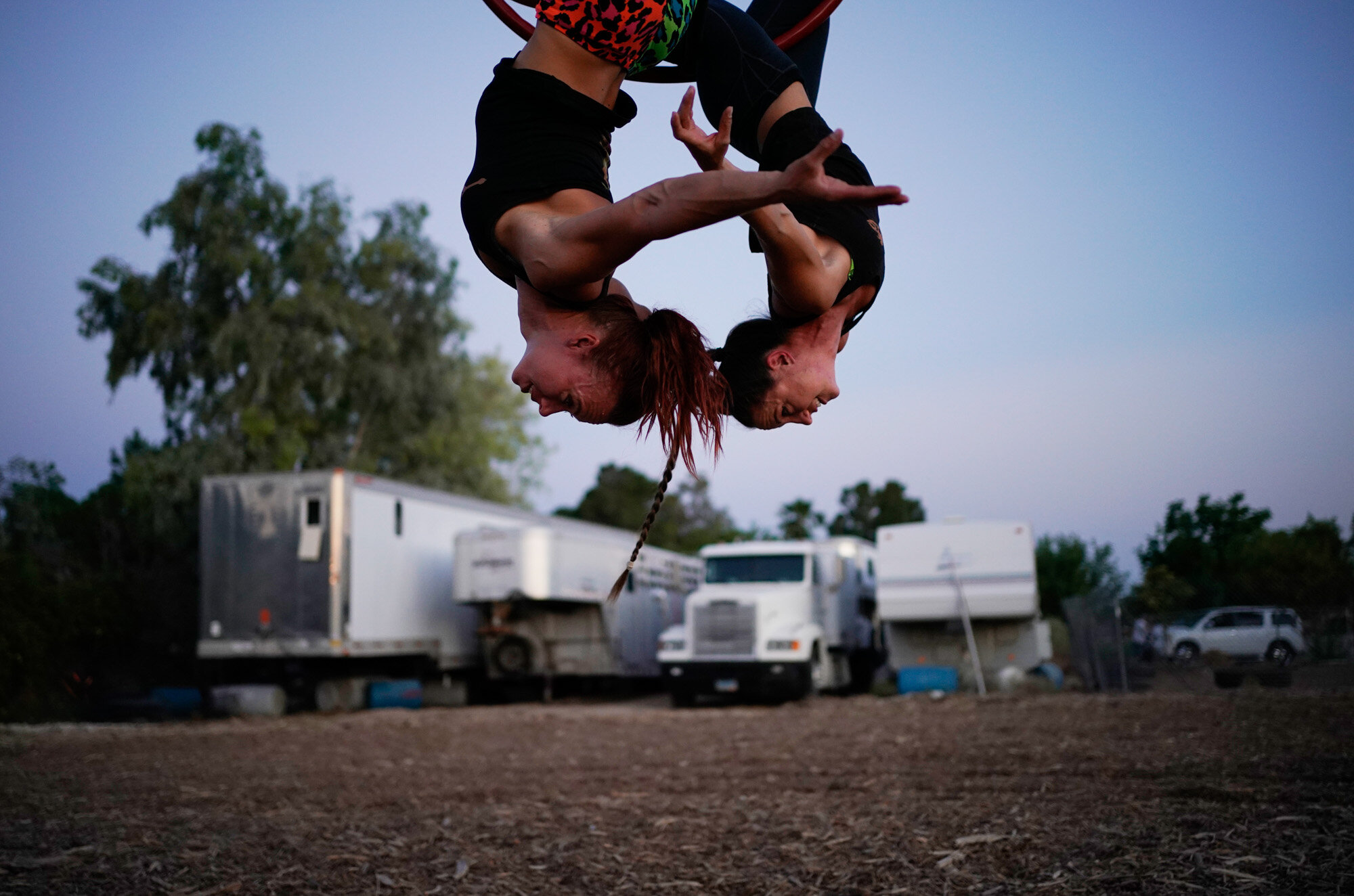 """Lisa Varmbo Martonovich, left, and Nicole England-Czyzewski practice an aerial routine for """"Gladius The Show,"""" a touring equestrian and acrobatic show, on May 28, 2020, in Las Vegas. The coronavirus forced the producers to cancel all of their performances through 2020. (AP Photo/John Locher)"""