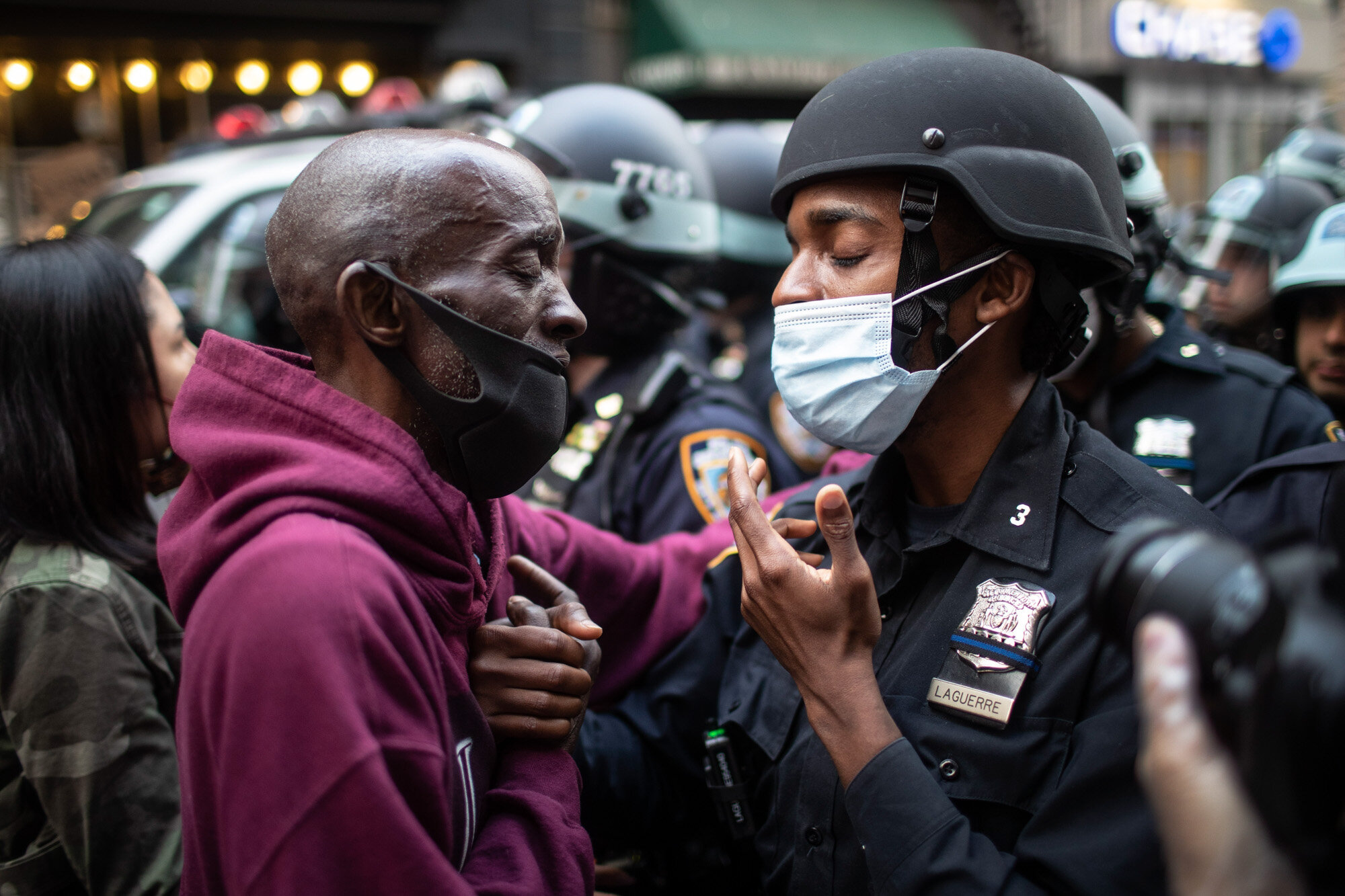 A protester and a police officer shake hands in the middle of a standoff during a rally in New York on June 2, 2020, calling for justice over the death of George Floyd, a Black man who died under the knee of a white police officer in Minneapolis on May 25. (AP Photo/Wong Maye-E)