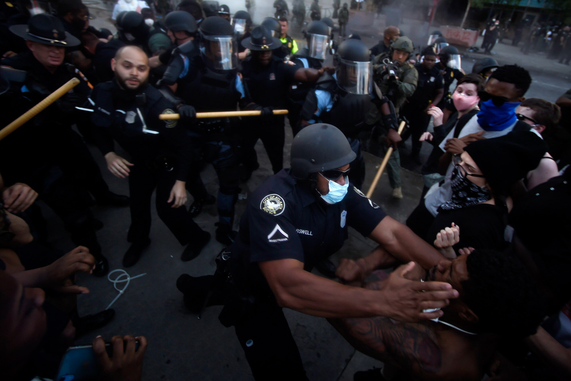 Police officers and protesters clash in Atlanta on May 29, 2020, during a protest in response to George Floyd's death in police custody in Minneapolis. Floyd, a Black man, died after a white police officer pressed a knee into his neck for several minutes even after he stopped moving and pleading for air. (AP Photo/Mike Stewart)