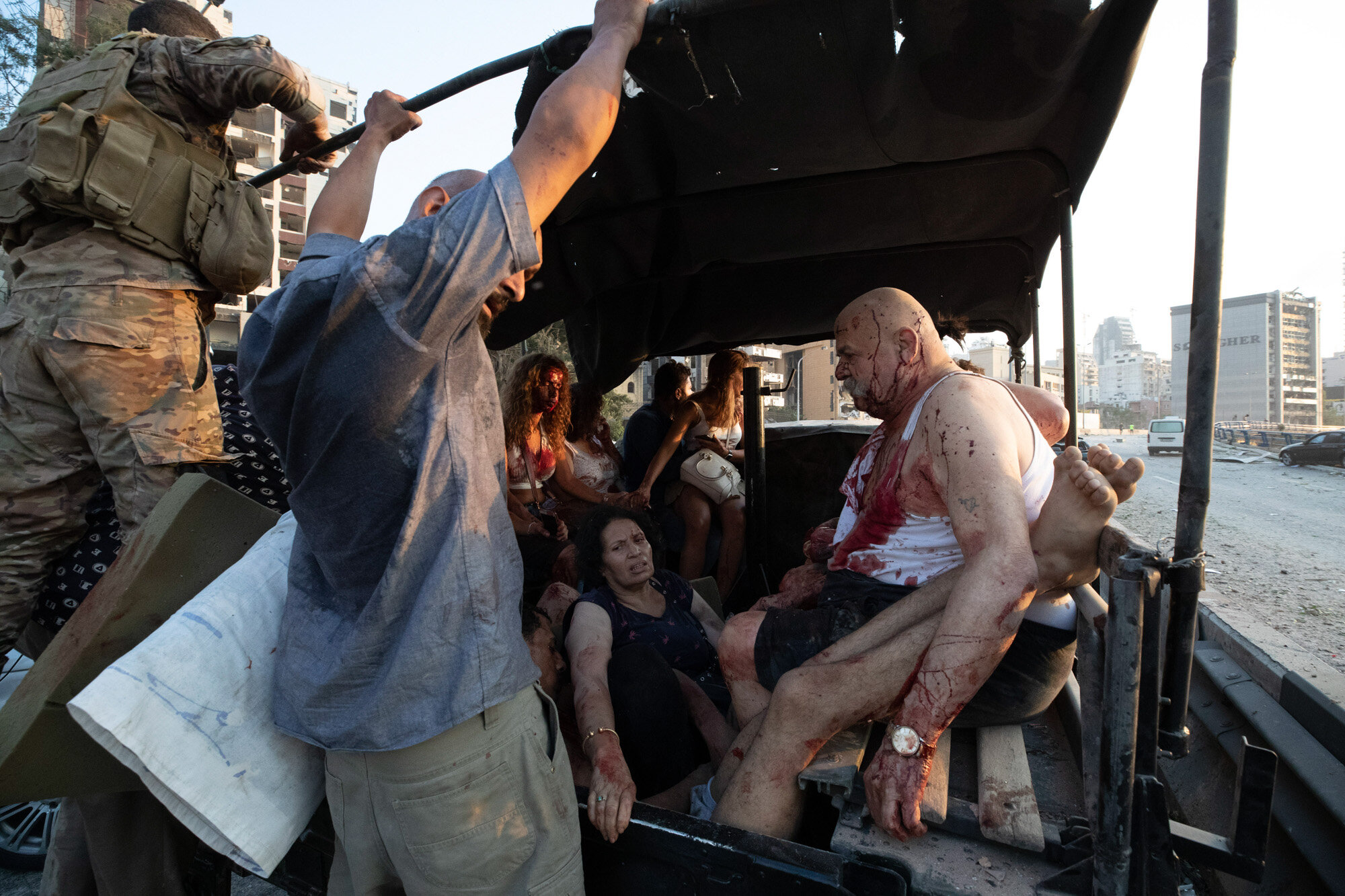 Injured people are evacuated shortly after a massive explosion at the port in Beirut, Lebanon, on Aug. 4, 2020. (AP Photo/Hassan Ammar)