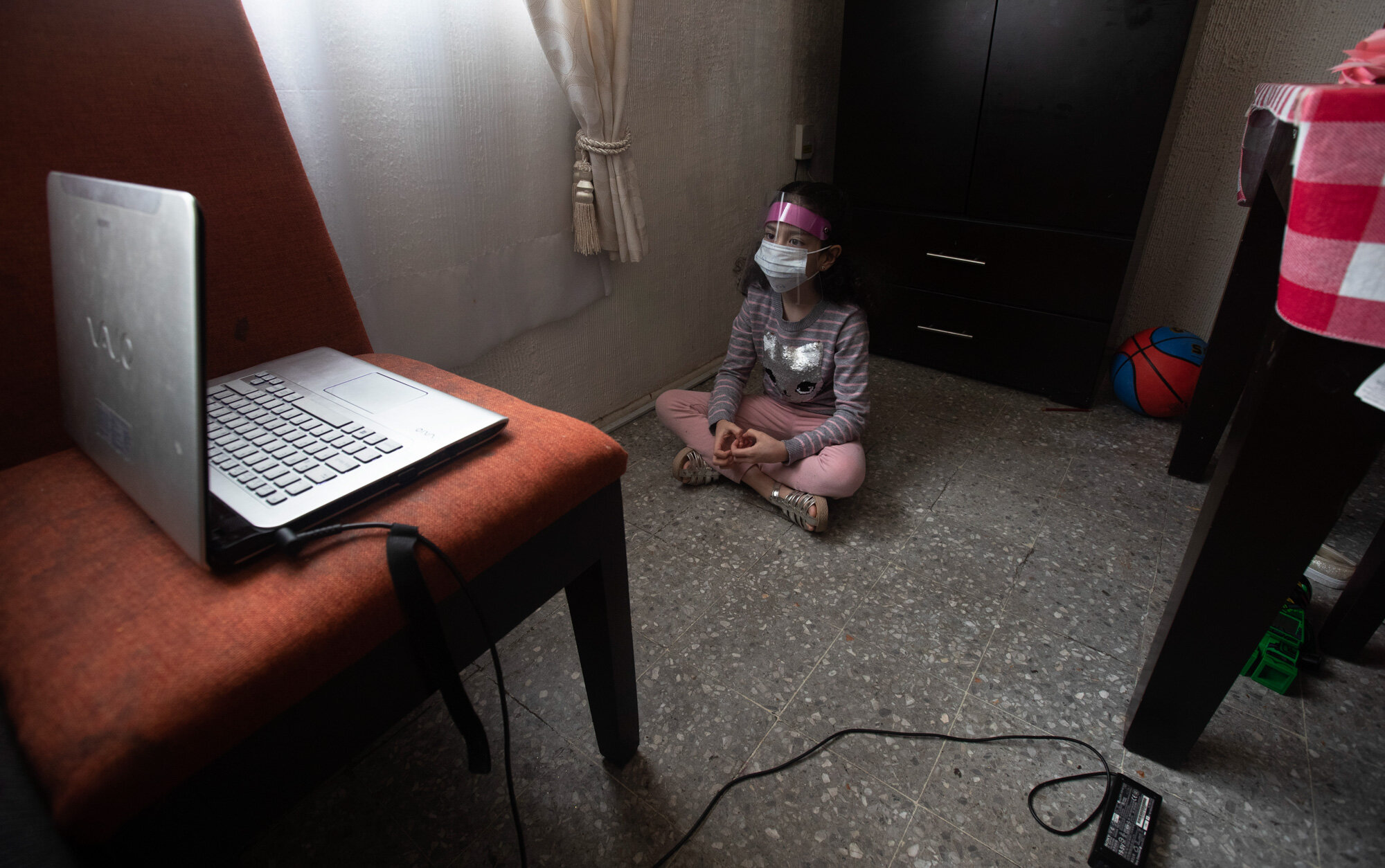 Monserrat Medina Zentella attends school via the internet from her home in Mexico City on Aug. 24, 2020, amid the coronavirus pandemic. (AP Photo/Marco Ugarte)