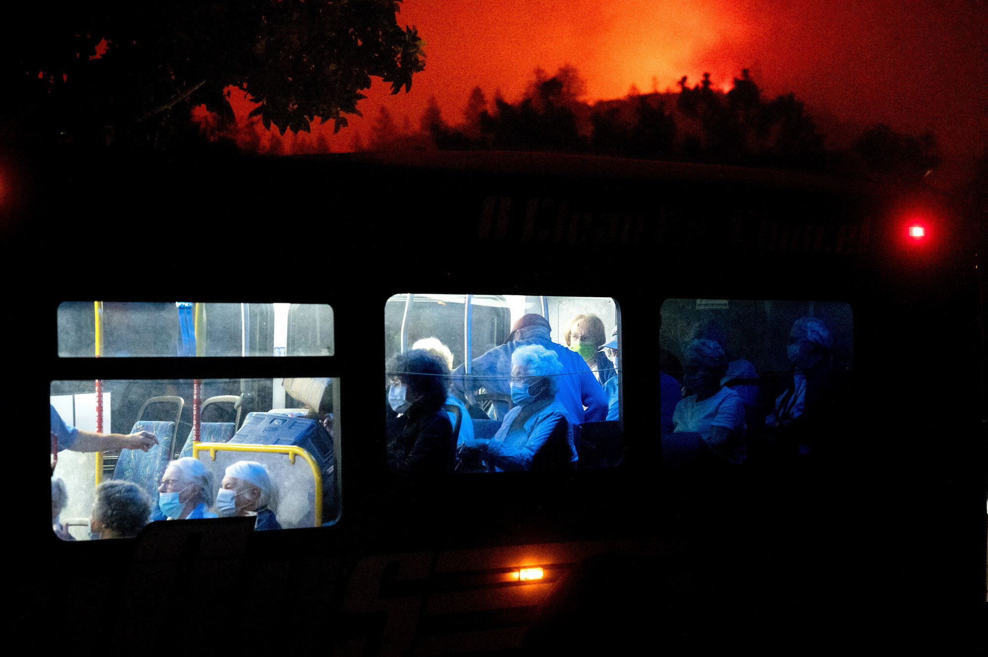 Residents of the Oakmont Gardens senior home evacuate on a bus as the Shady Fire approaches in Santa Rosa Calif., on Sept. 28, 2020. (AP Photo/Noah Berger)
