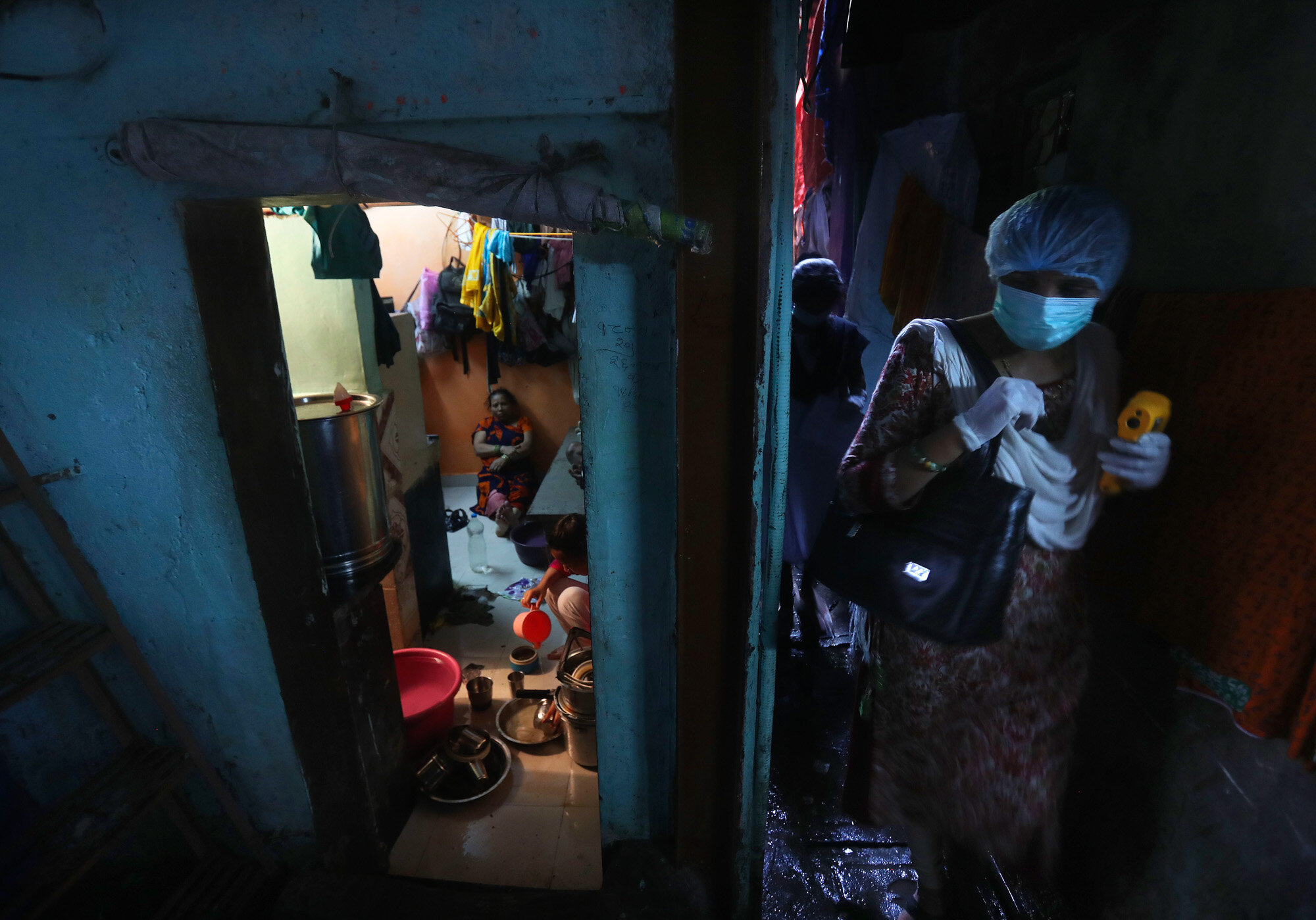 A health worker arrives to screen people for symptoms of COVID-19 on Sept. 4, 2020, in Dharavi, one of Asia's biggest slums, in Mumbai, India. (AP Photo/Rafiq Maqbool)