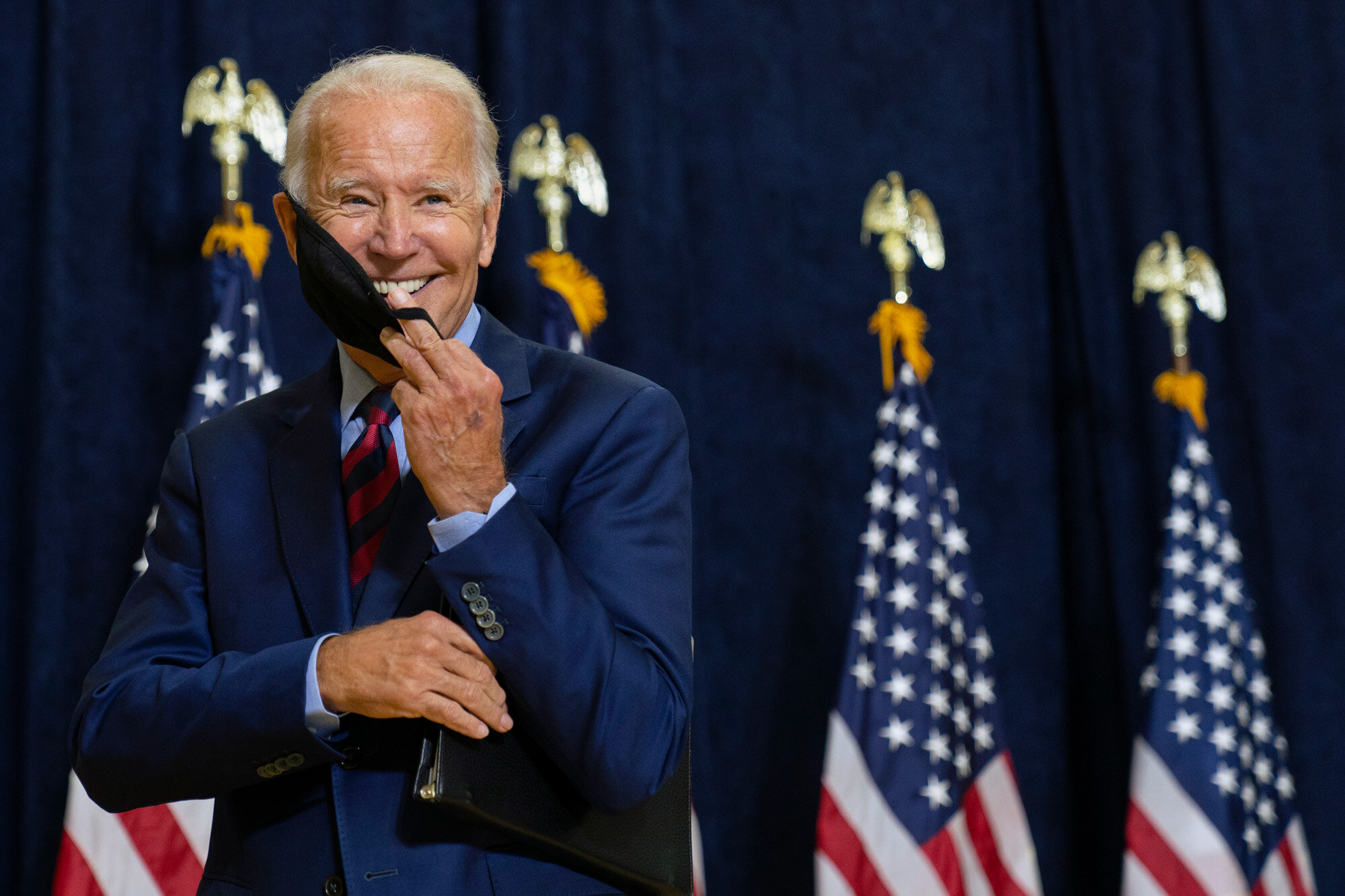 Democratic presidential candidate former Vice President Joe Biden smiles as he puts on his face mask after speaking to media in Wilmington, Del., on Sept. 4, 2020. (AP Photo/Carolyn Kaster)