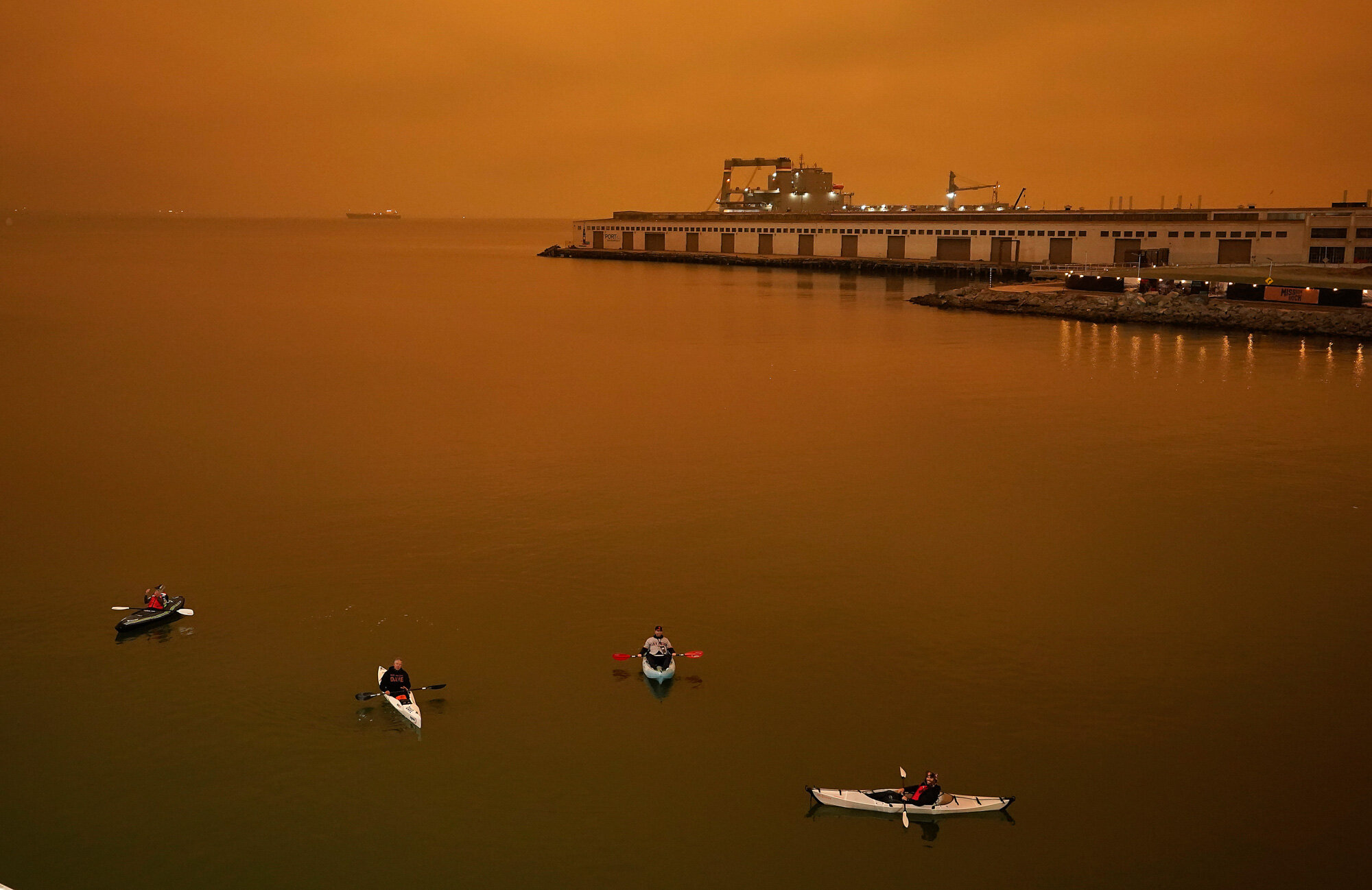 People in kayaks paddle in McCovey Cove outside Oracle Park in San Francisco during a baseball game between the San Francisco Giants and the Seattle Mariners on Sept. 9, 2020. (AP Photo/Tony Avelar)