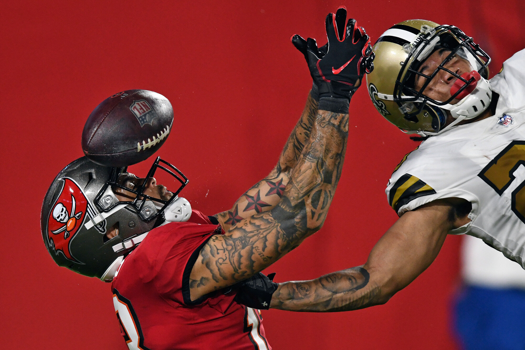 New Orleans Saints cornerback Marshon Lattimore, right, knocks the ball away from Tampa Bay Buccaneers wide receiver Mike Evans in the end zone on a fourth down during the second half of an NFL football game on Nov. 8, 2020, in Tampa, Fla. (AP Photo/Jason Behnken)